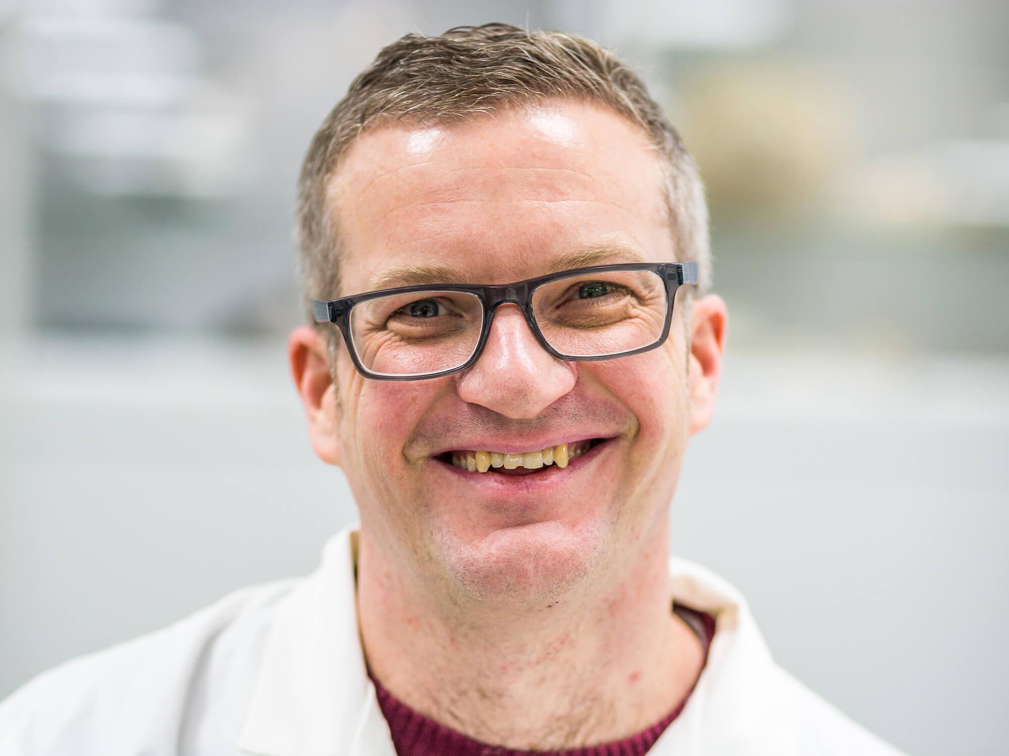 Headshot of Ian Turner smiling