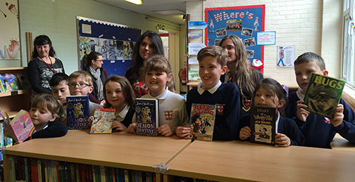St George's School students in library holding books