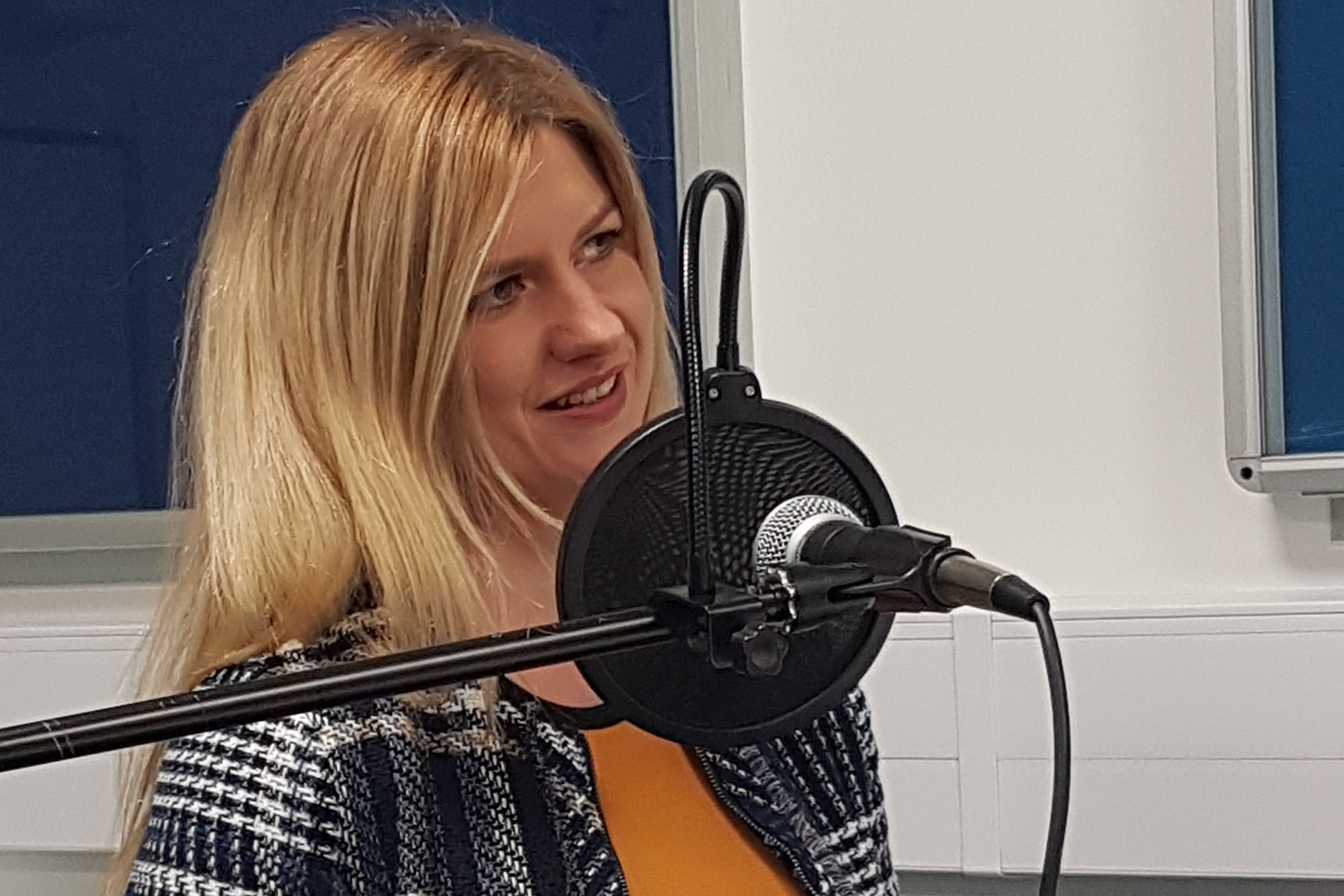 Nicole Yeomans at a microphone