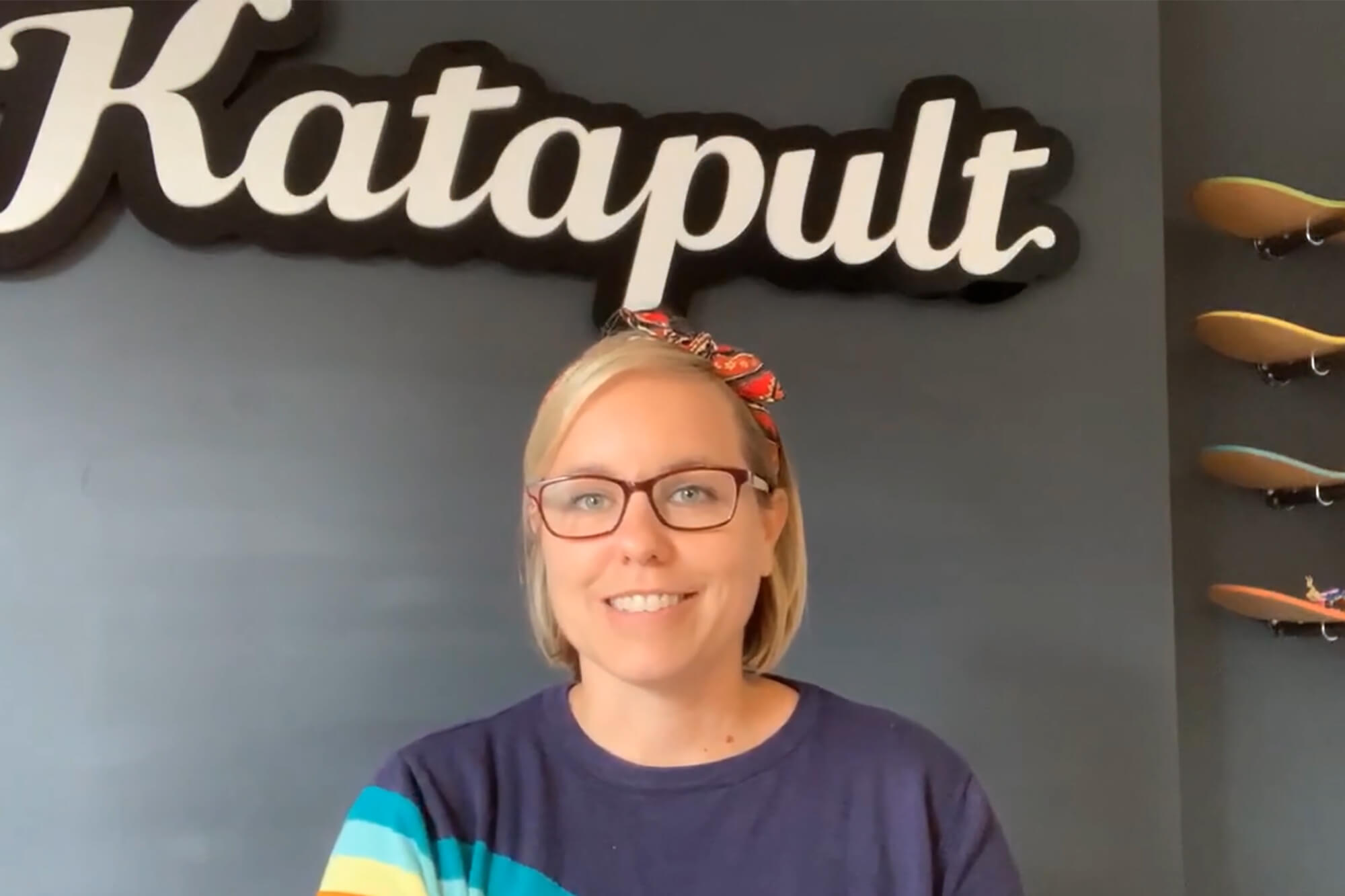 Dawn underneath the Katapult sign at her business