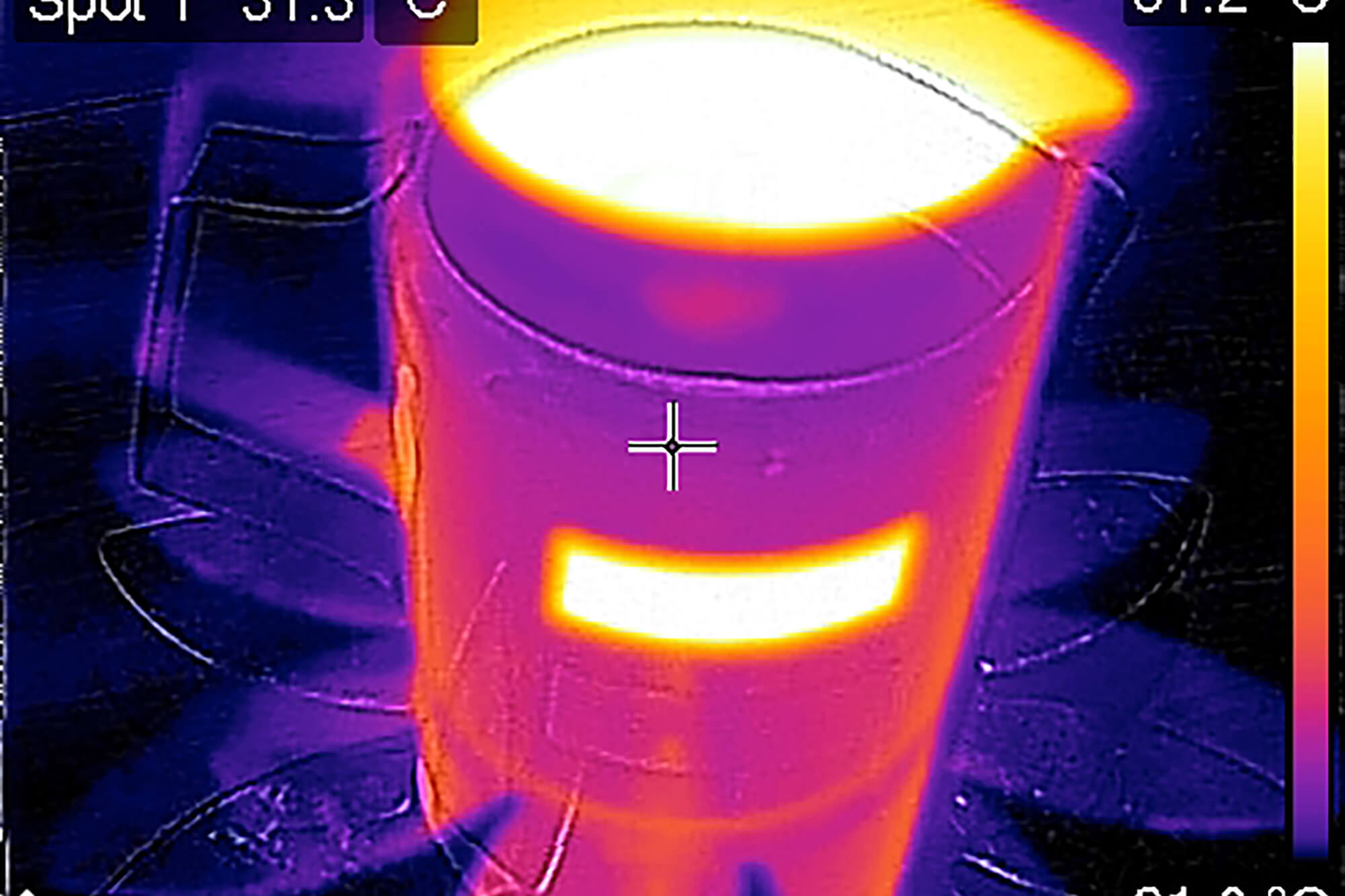 A thermal image of some warm milk in an insulated jug. The milk is at a high temperature of over 80 degrees and the body of the jug is at a relatively lower temperature, around 30 degrees.