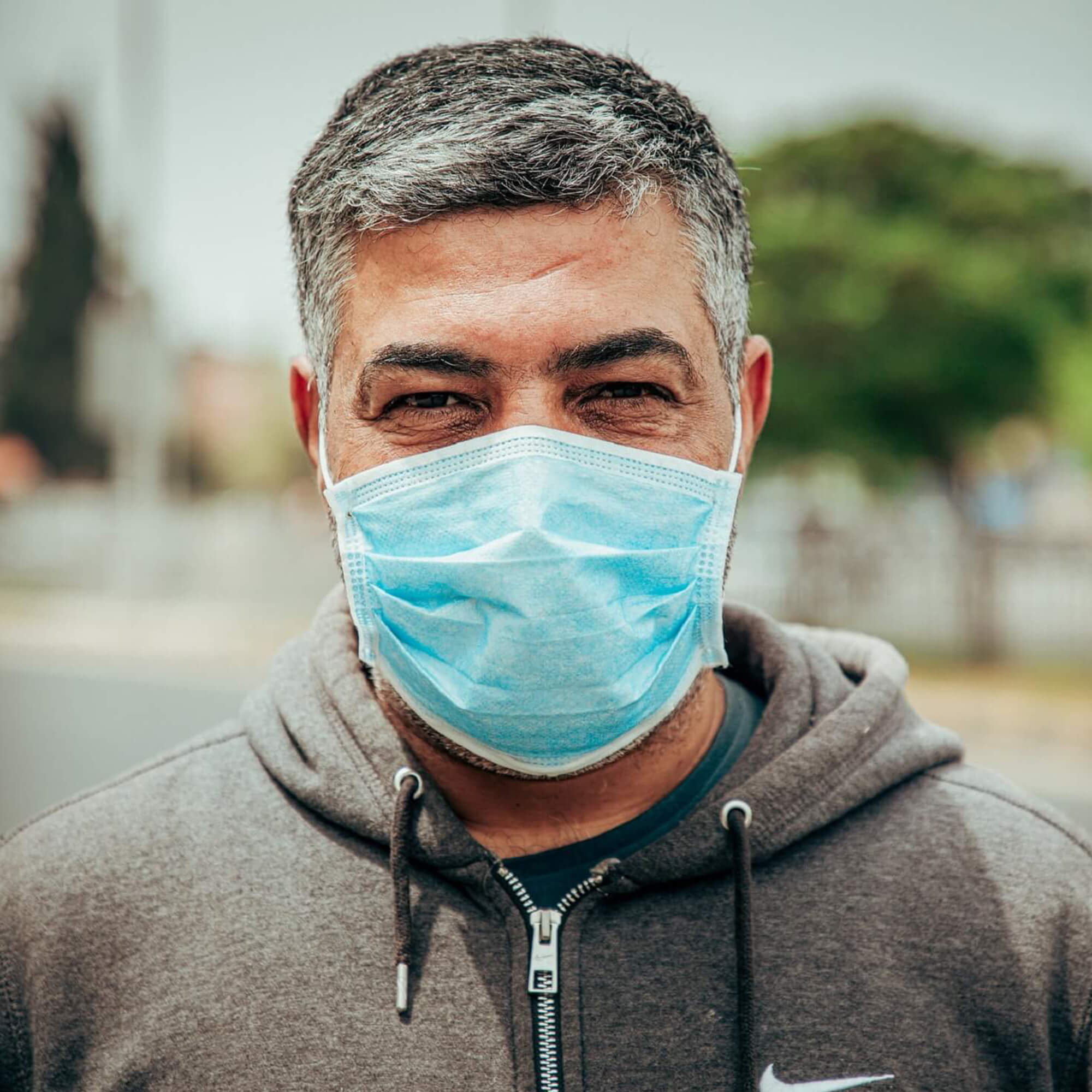 A man wearing a surgical face mask
