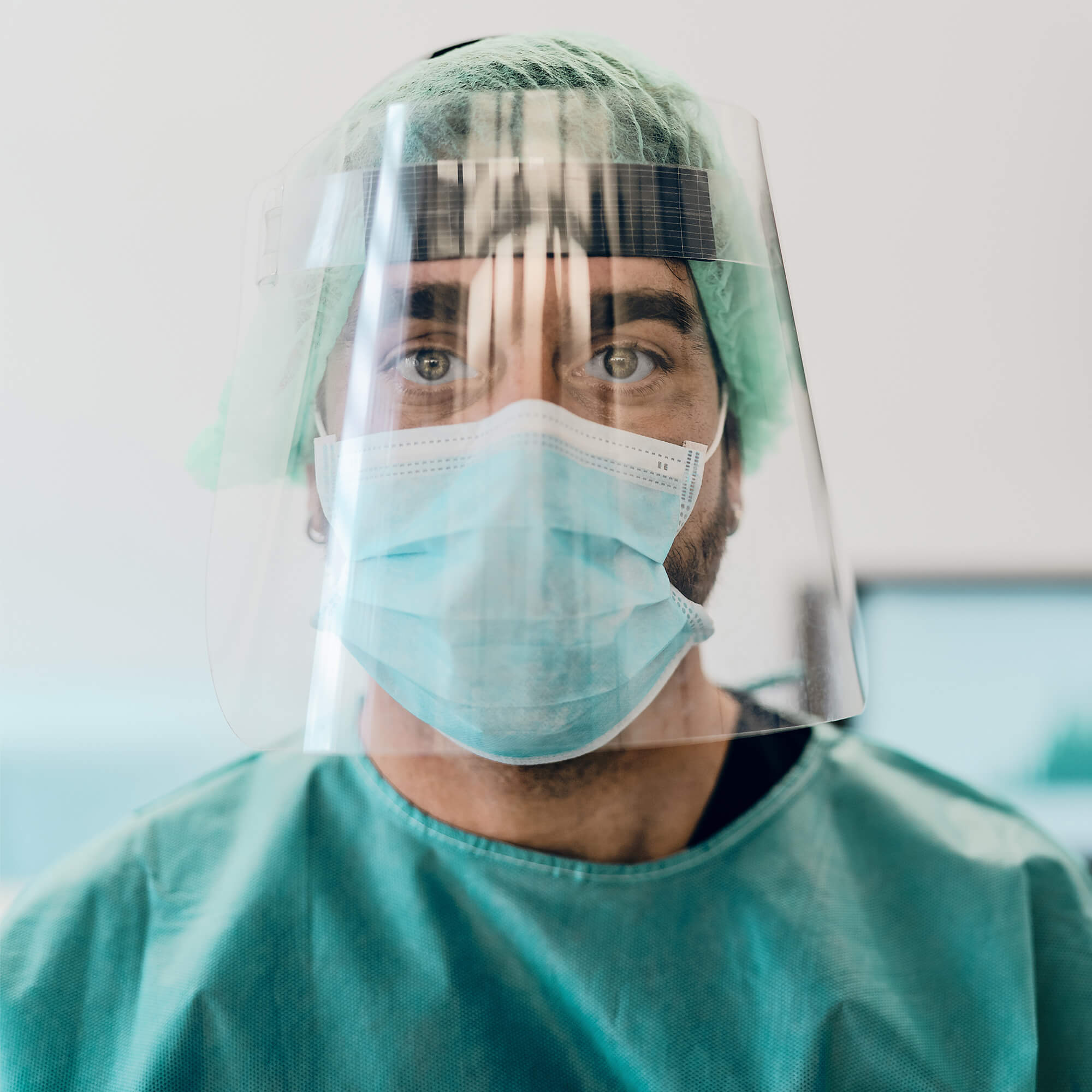 A medical professional wearing PPE