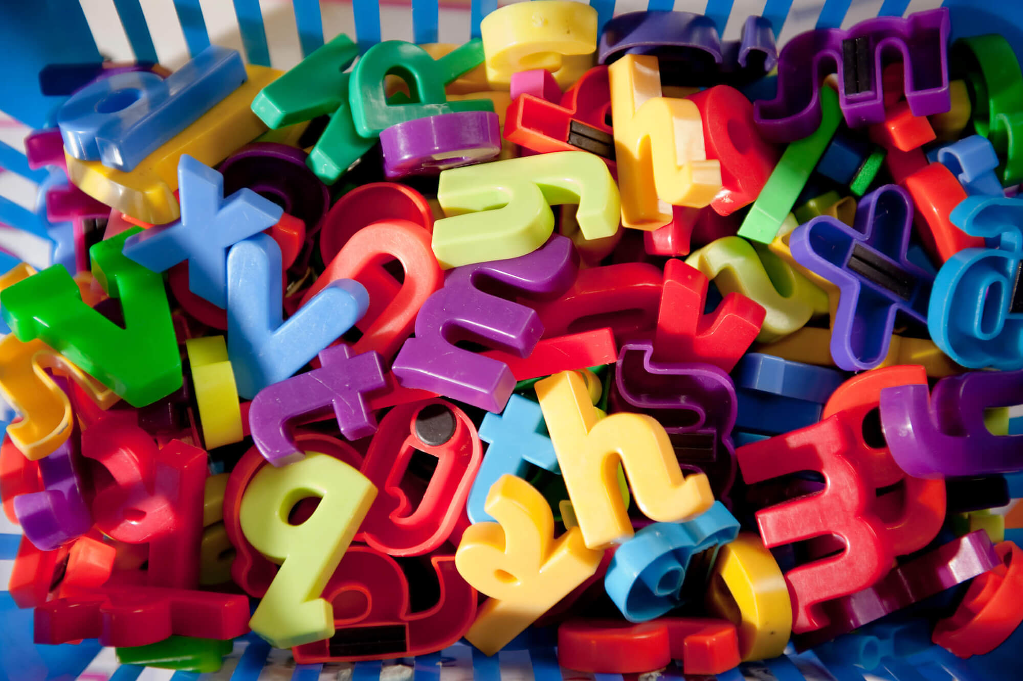 a pile of fridge magnet letters