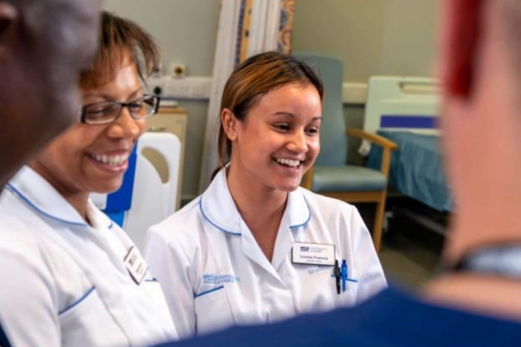 Group of nursing students stood together smiling