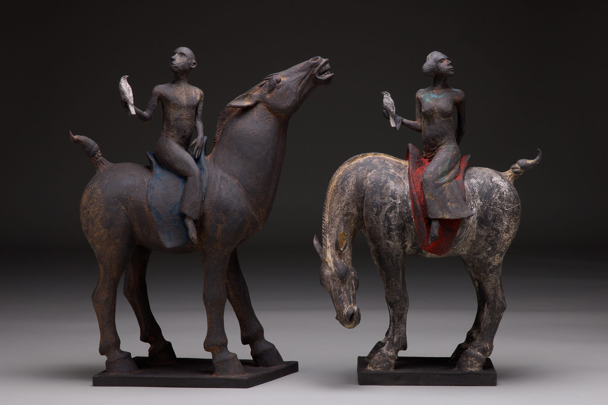 Cast figures on horses with hawks