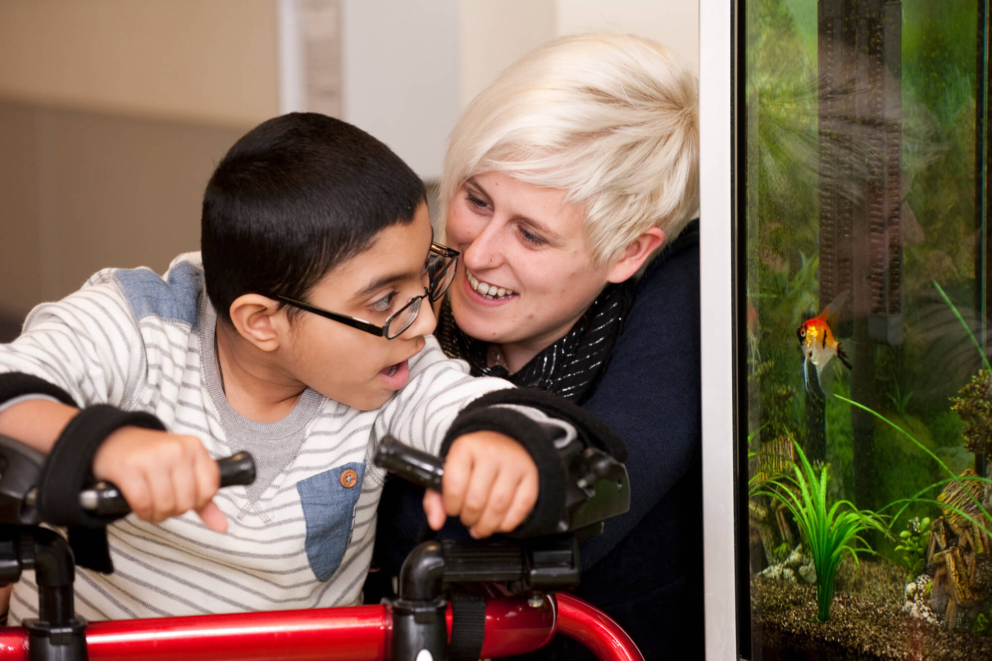 a teacher with a young person with special educational needs and disability