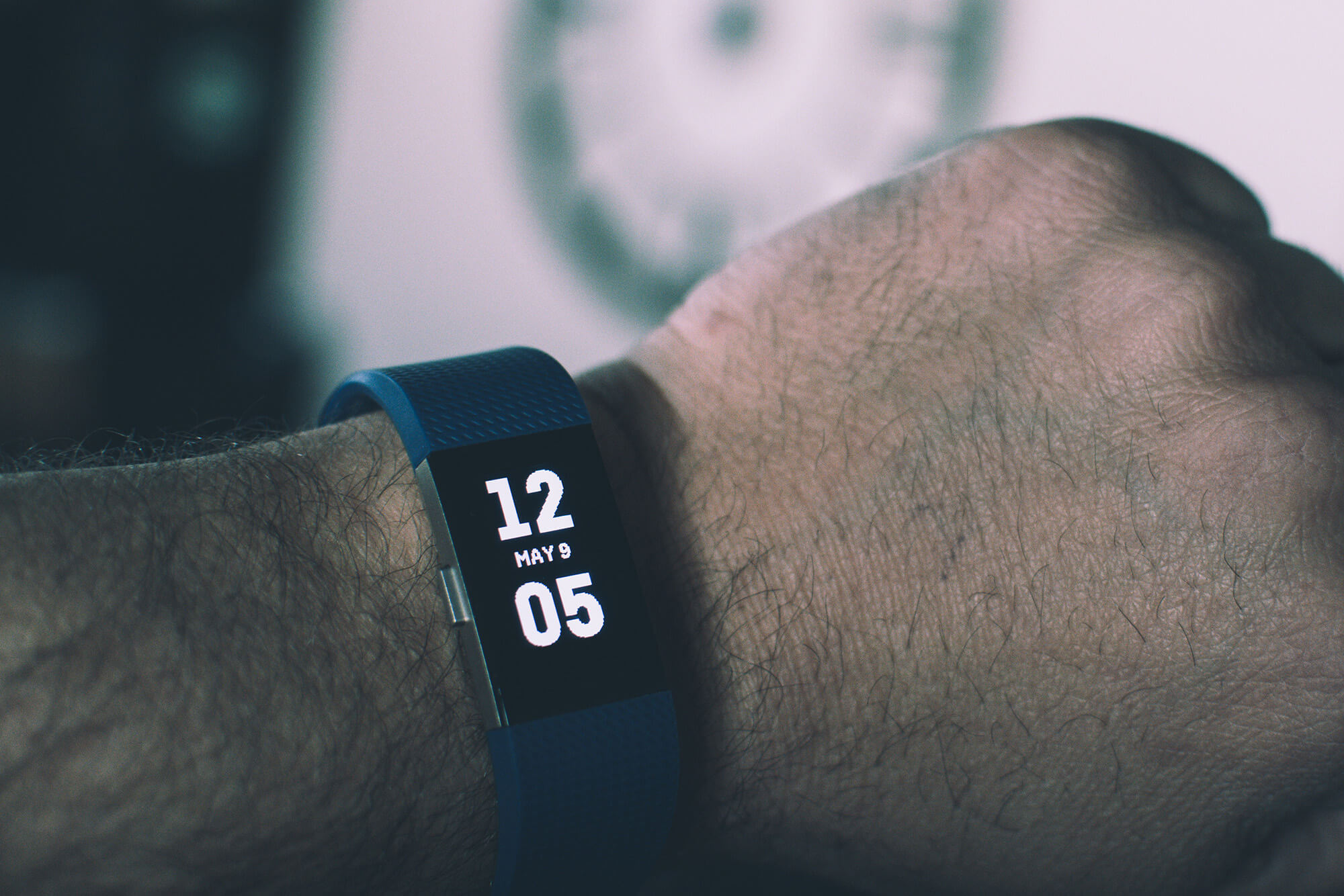 A fitness gadget on a man's wrist