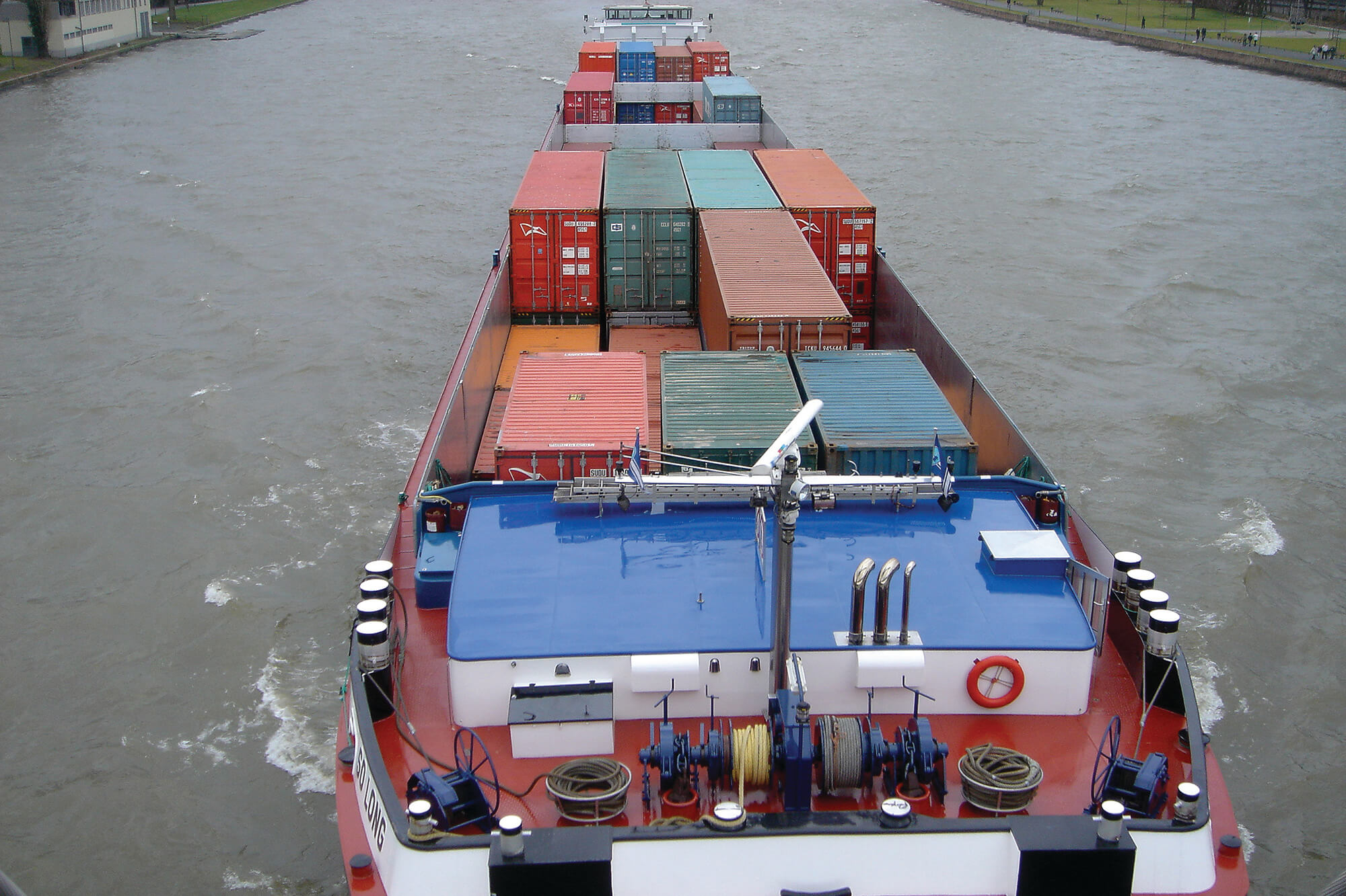 A container ship on a waterway