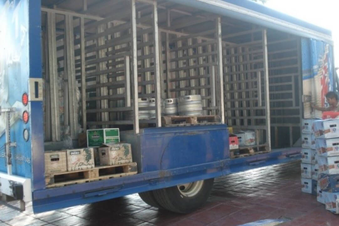 A truck being loaded with beer