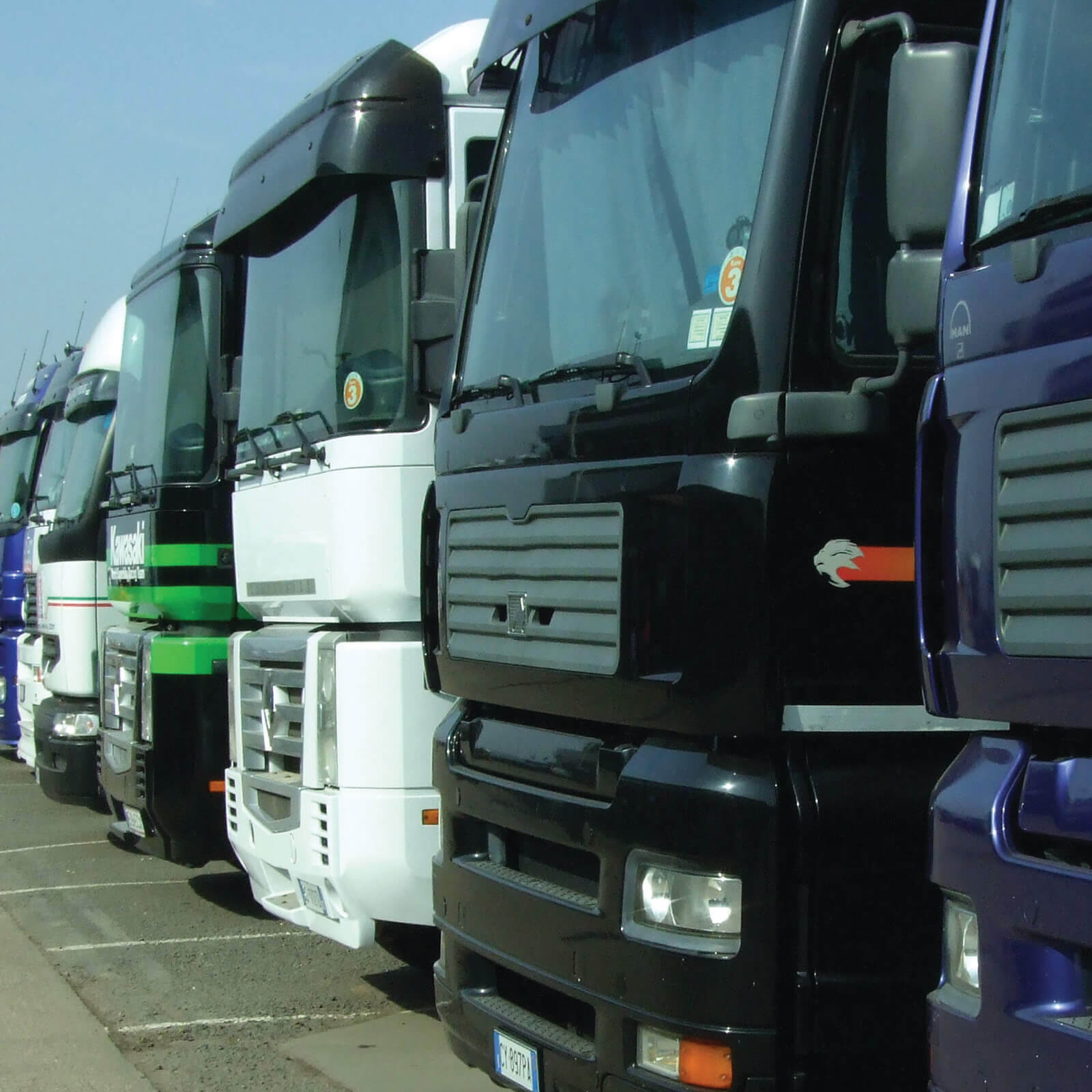 a line of parked heavy goods vehicles