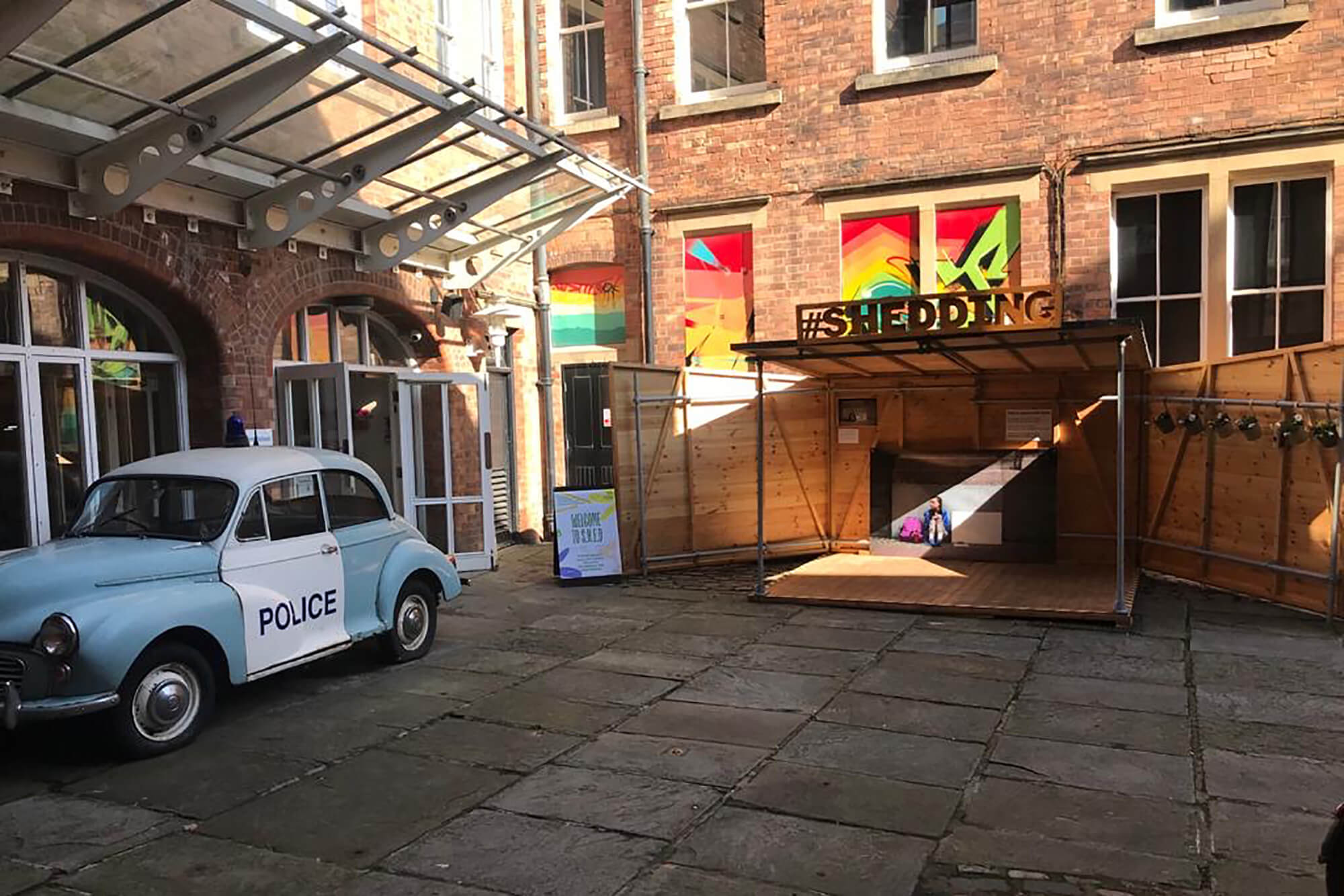 S.H.E.D at the National Justice Museum, Nottingham, next to an old Morris Minor police car
