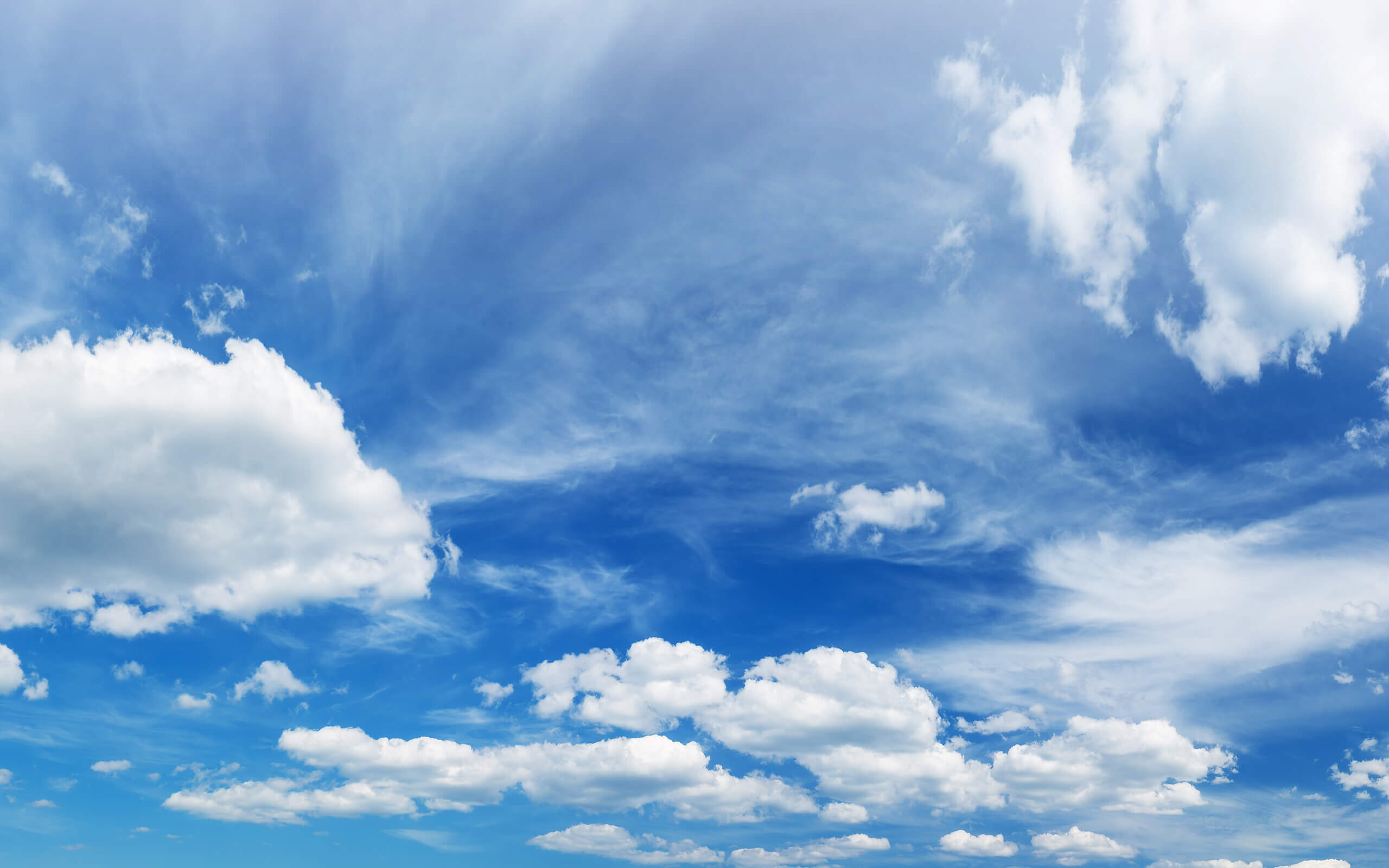 white clouds against a blue sky