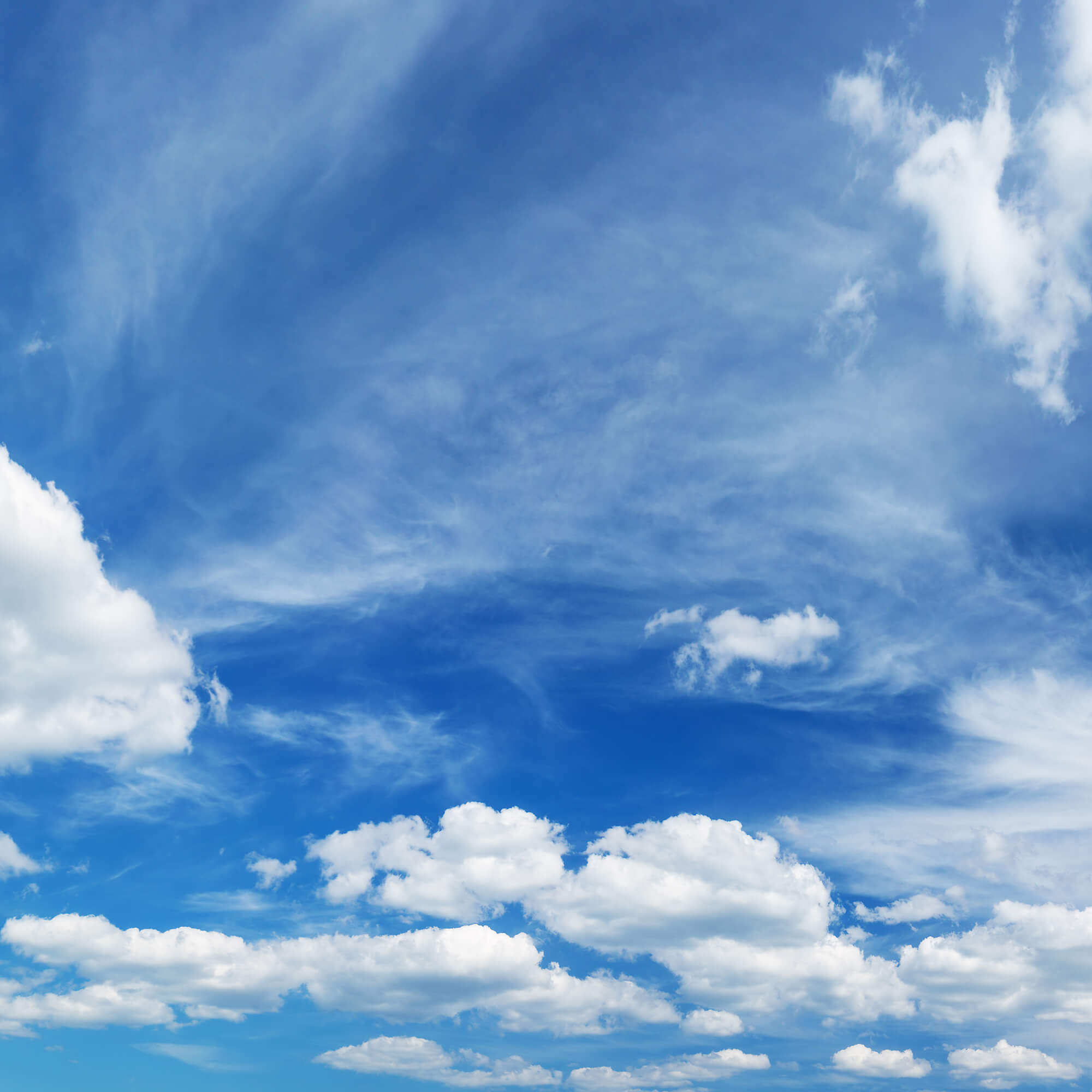 white clouds against a blue summer sky
