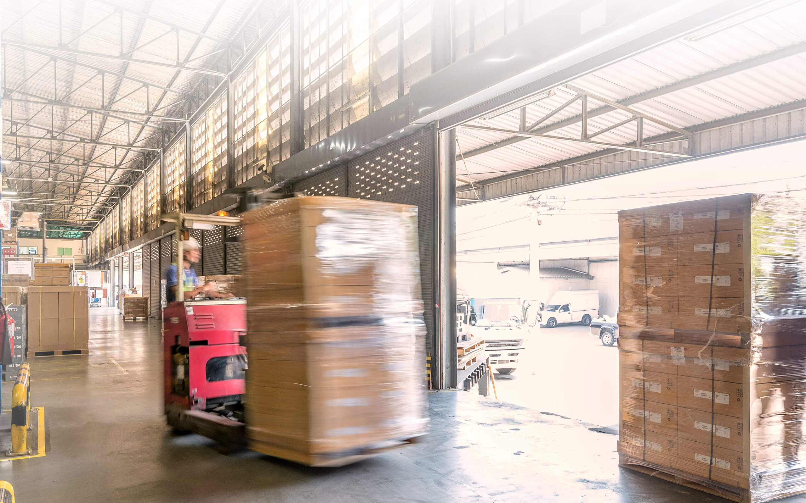 a forklift moving crates in a warehouse