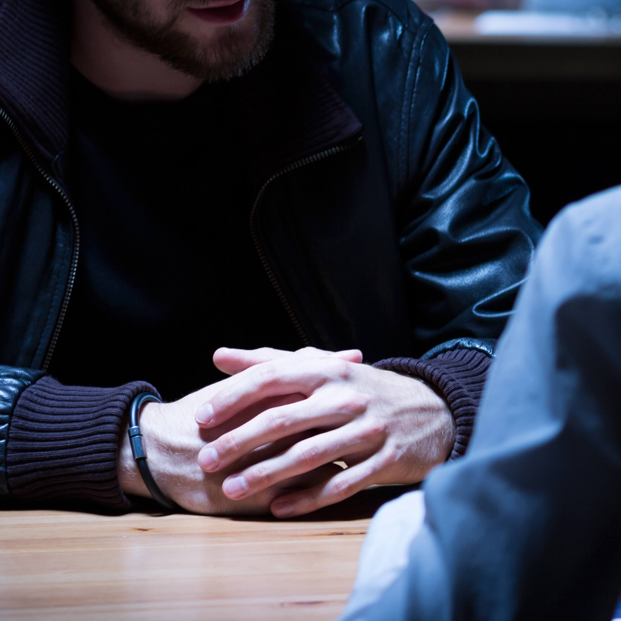 investigative interview taking place across a table