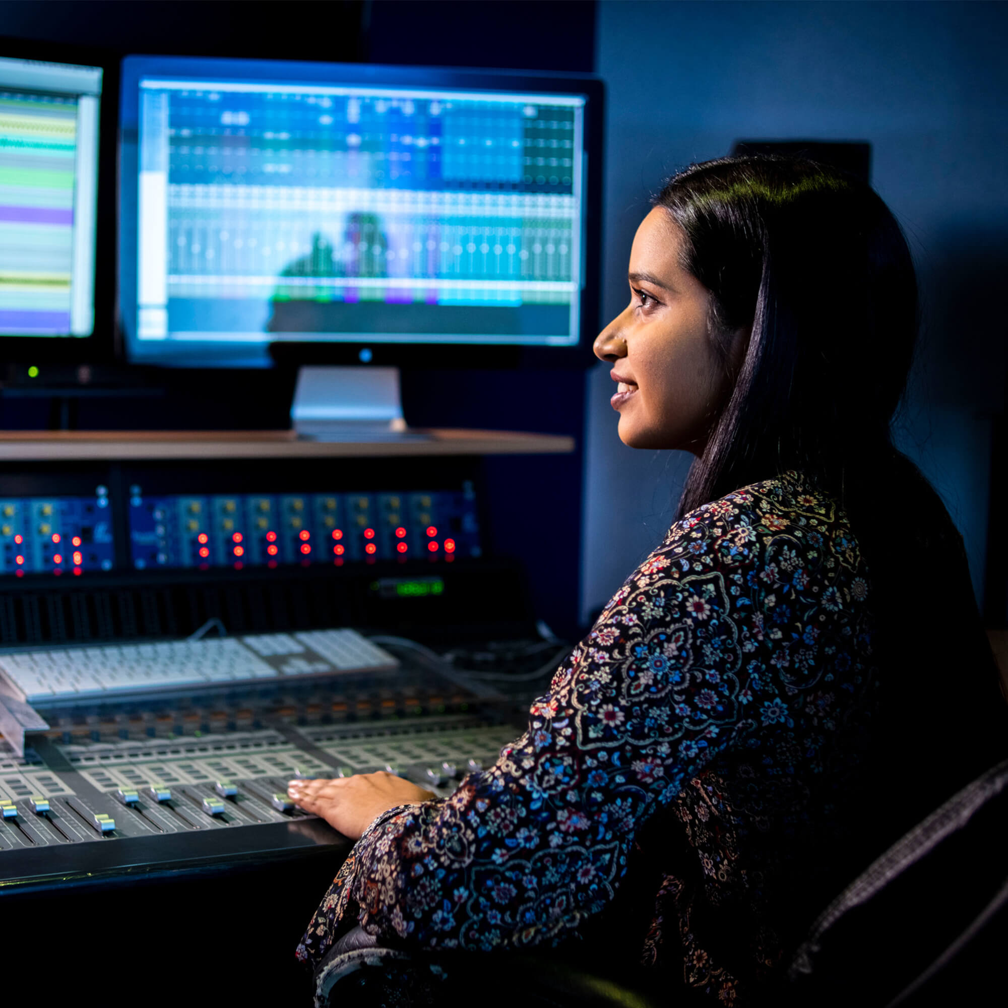 A student in a music production suite