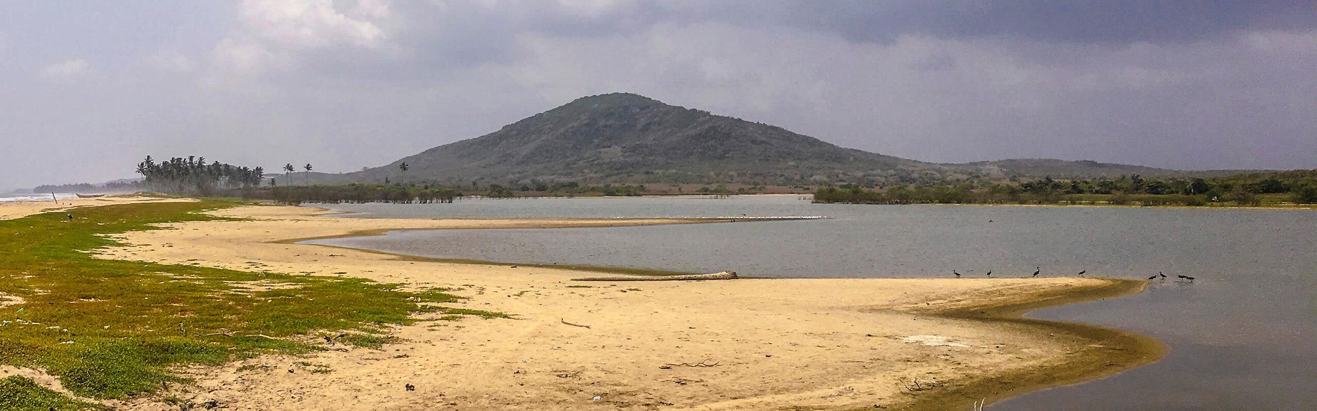 the Muni-Pomadze lagoon-barrier system in Winneba, Ghana