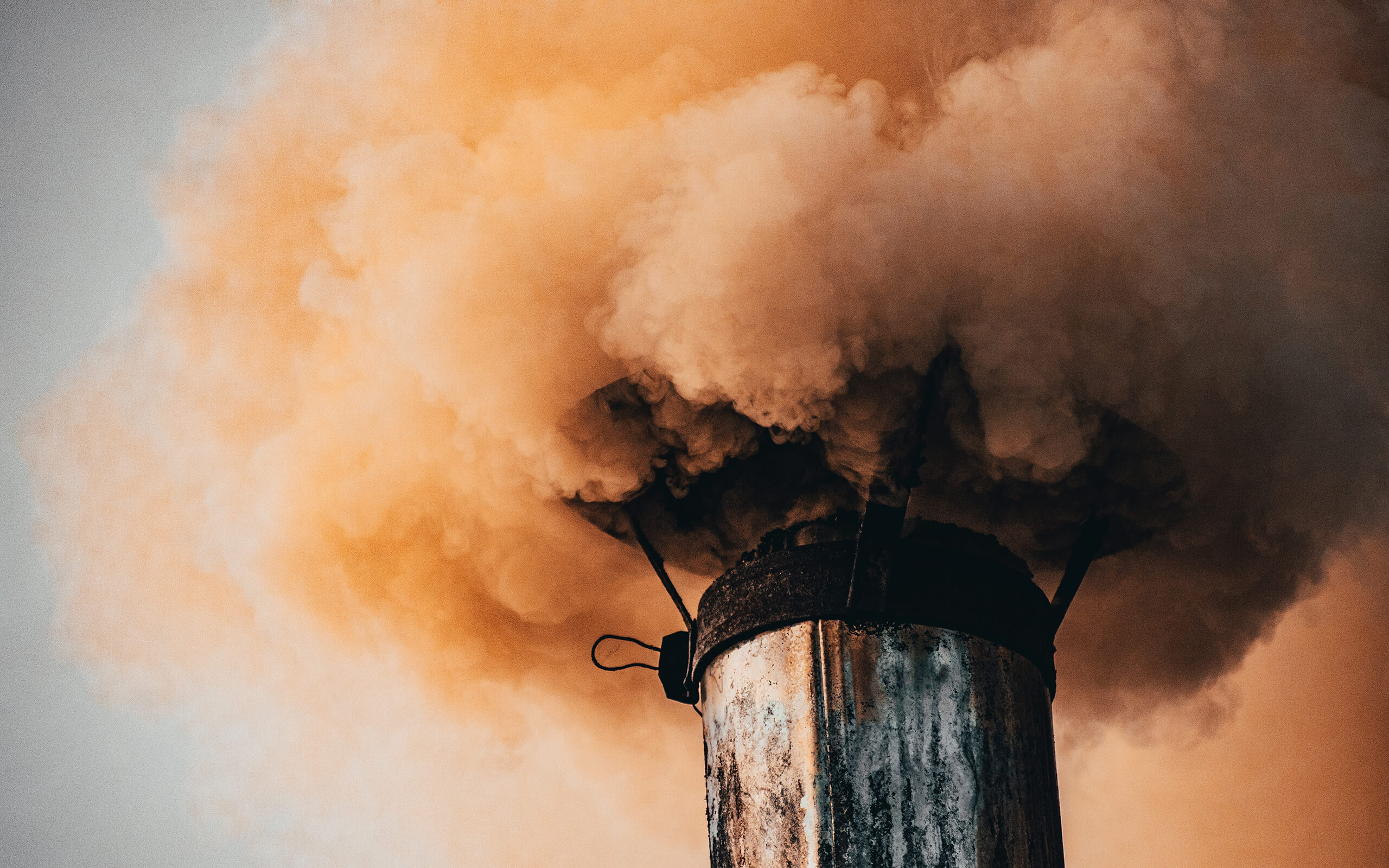 smoke billowing from an industrial chimney
