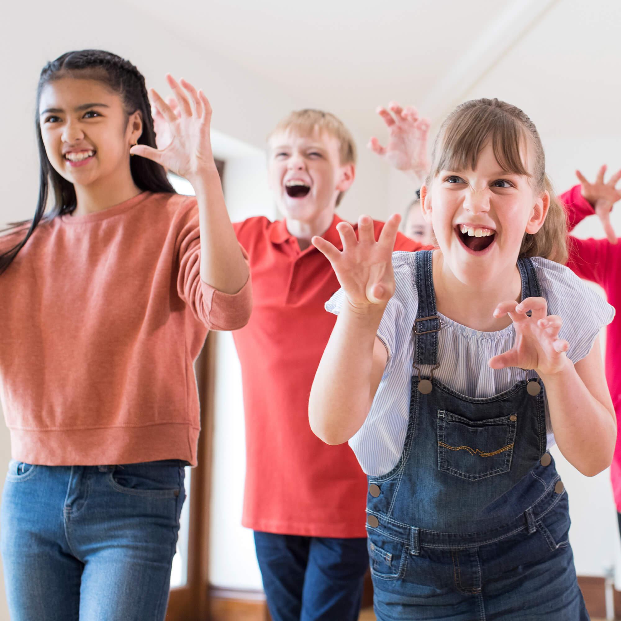 children taking part in a theatre workshop