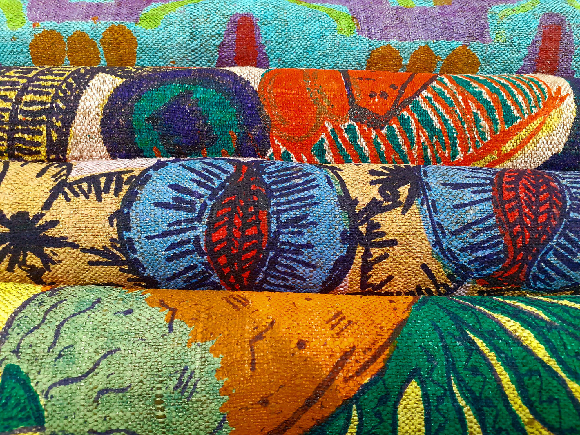 designs on fabric showing flowers, fruit and geometric shapes