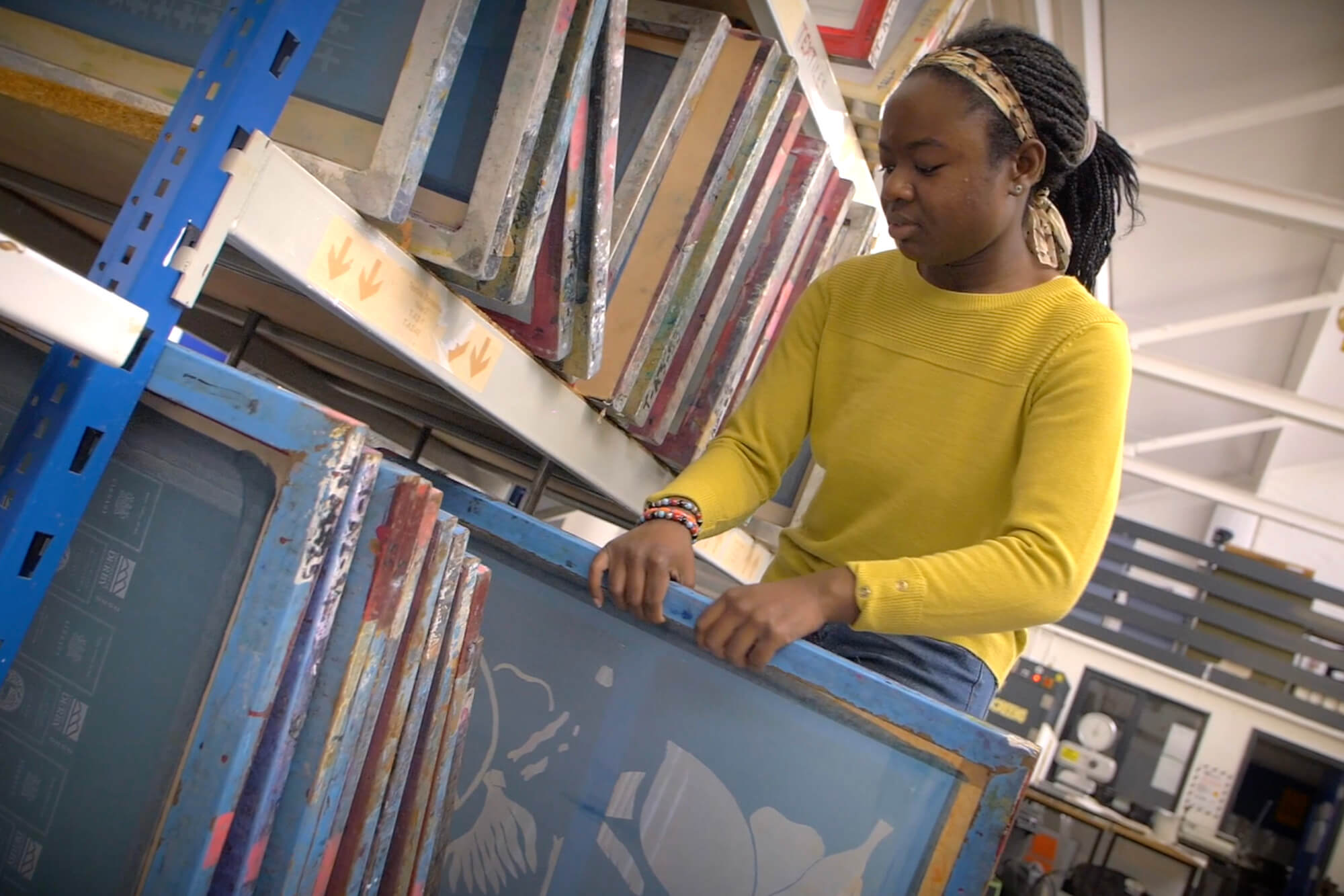 Jessica Boateng selecting screens for printing