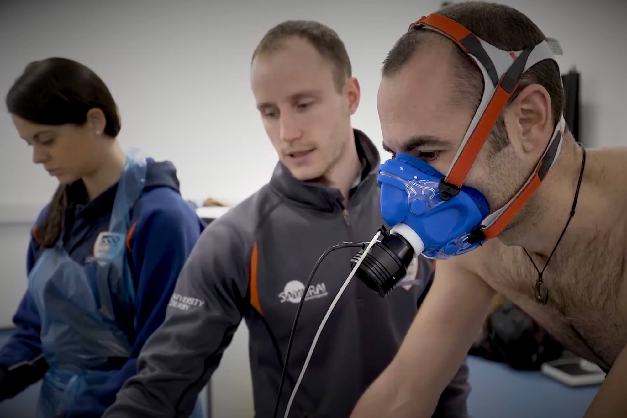 Mark Faghy carrying out tests with a cyclist wearing a breathing mask