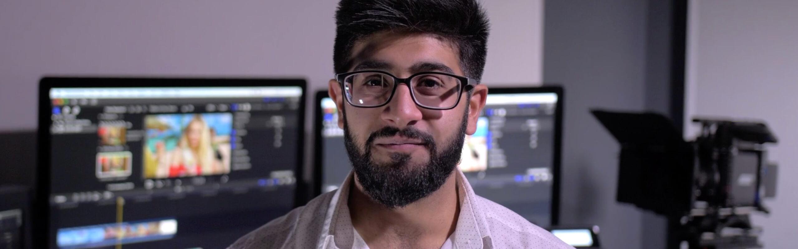 Omar Soomro in a film editing suite