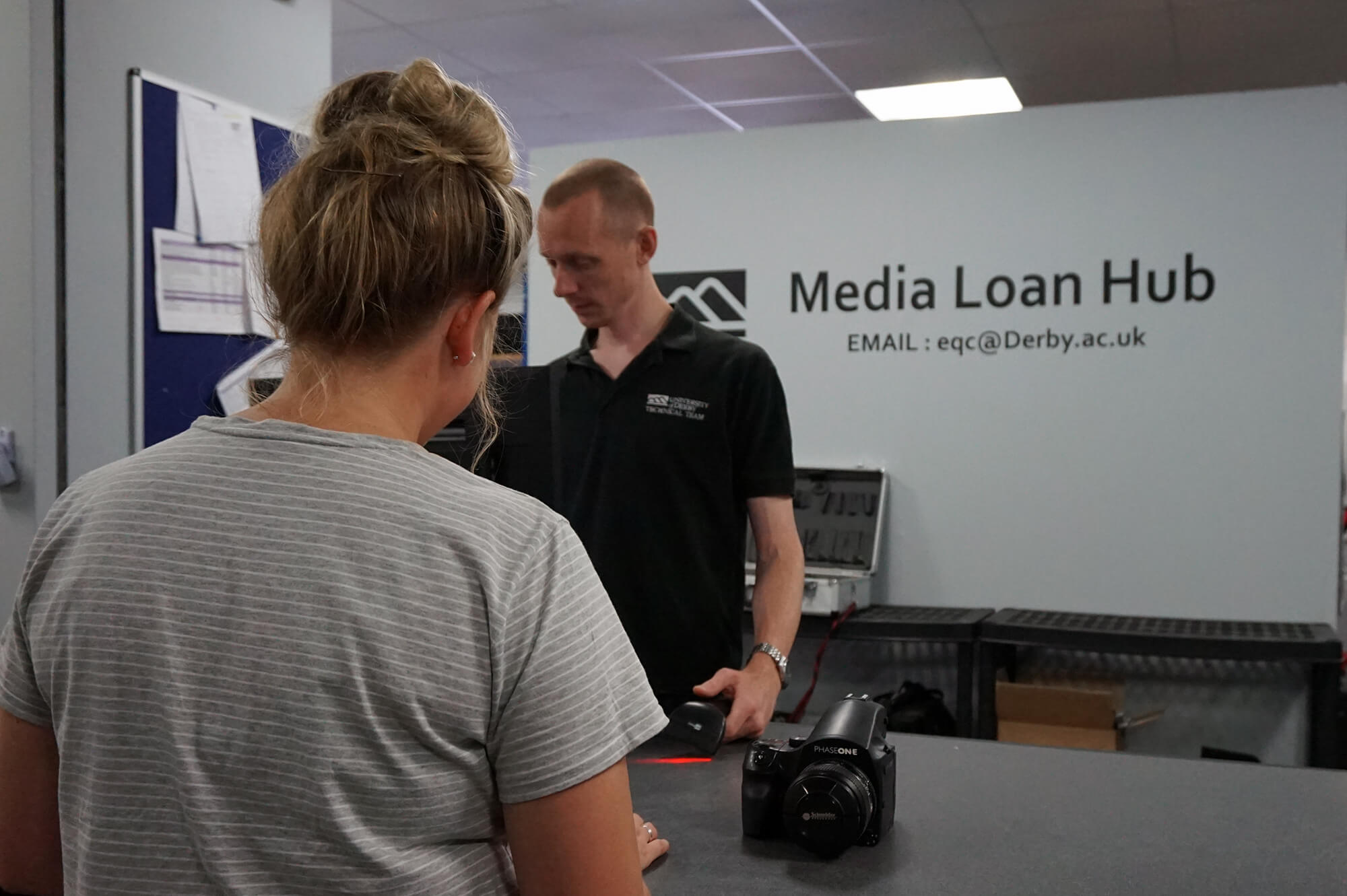 Student booking out equipment at the Media Loan Hub