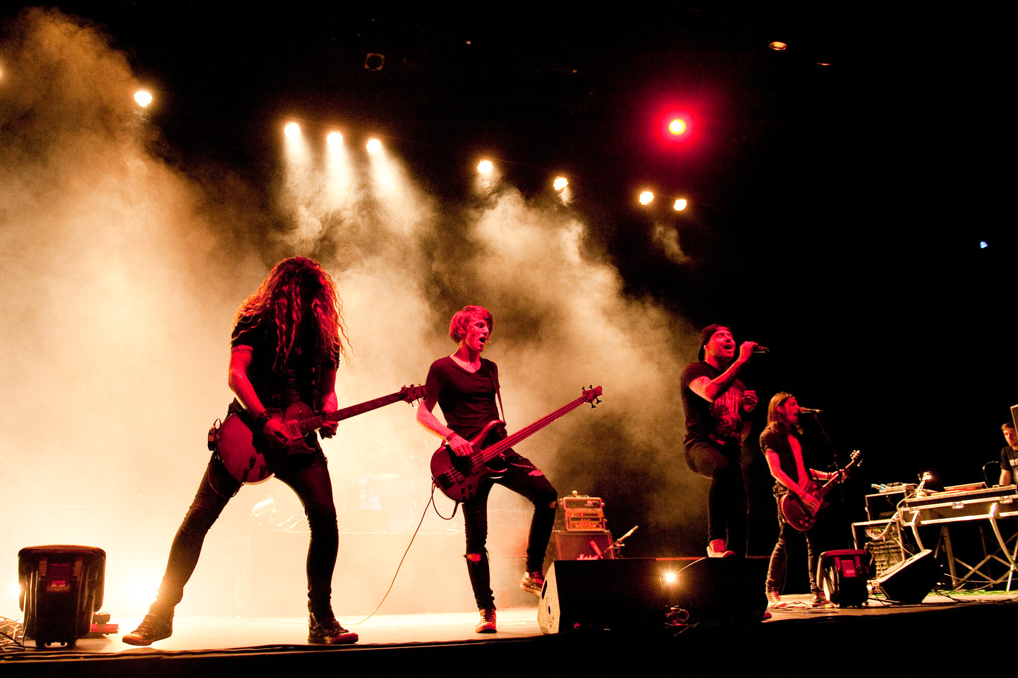 A rock band playing on stage at Derby theatre