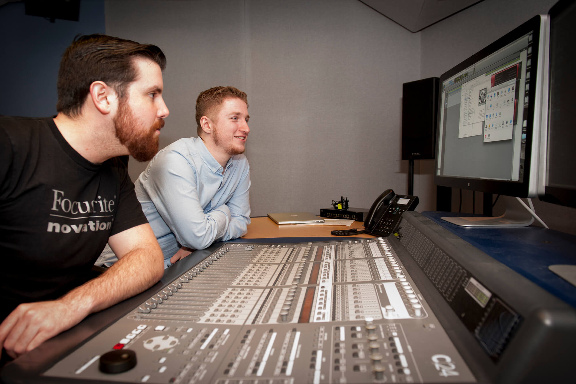 Two students working in the music studios