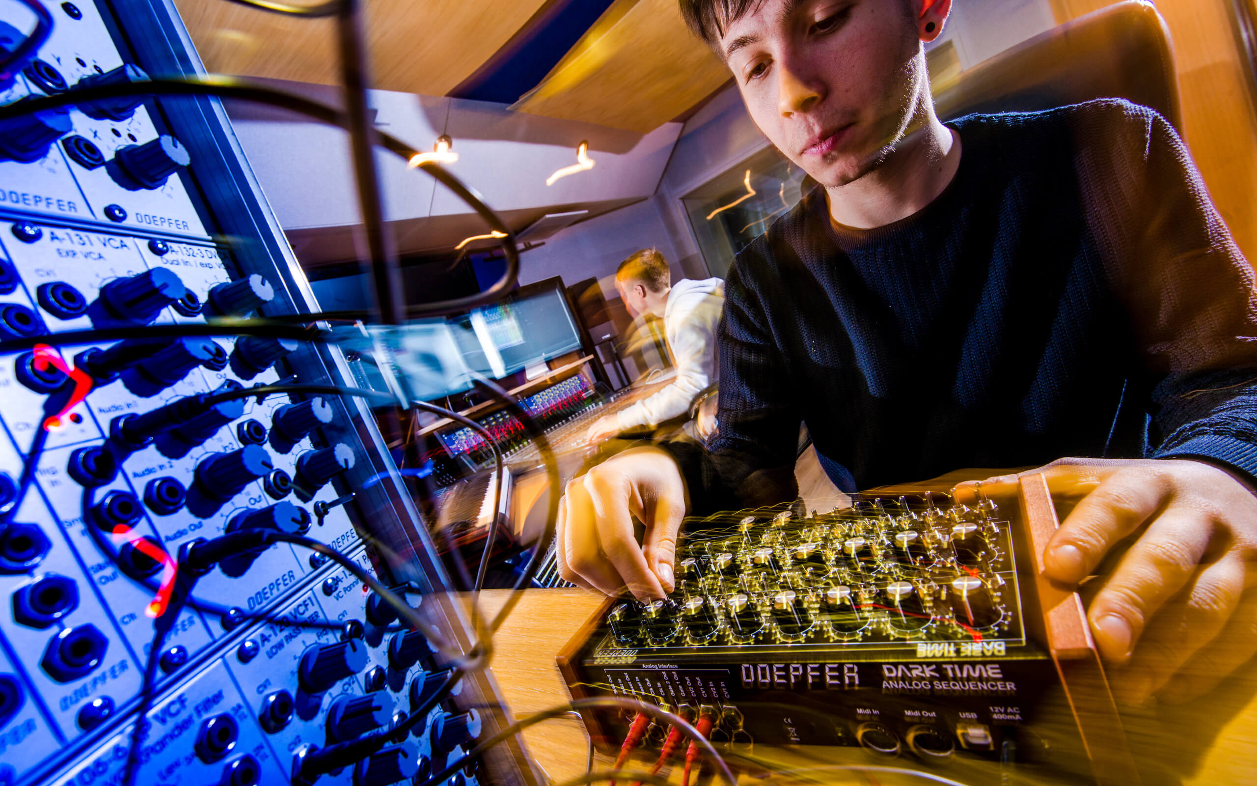 A student working in one of the music studios