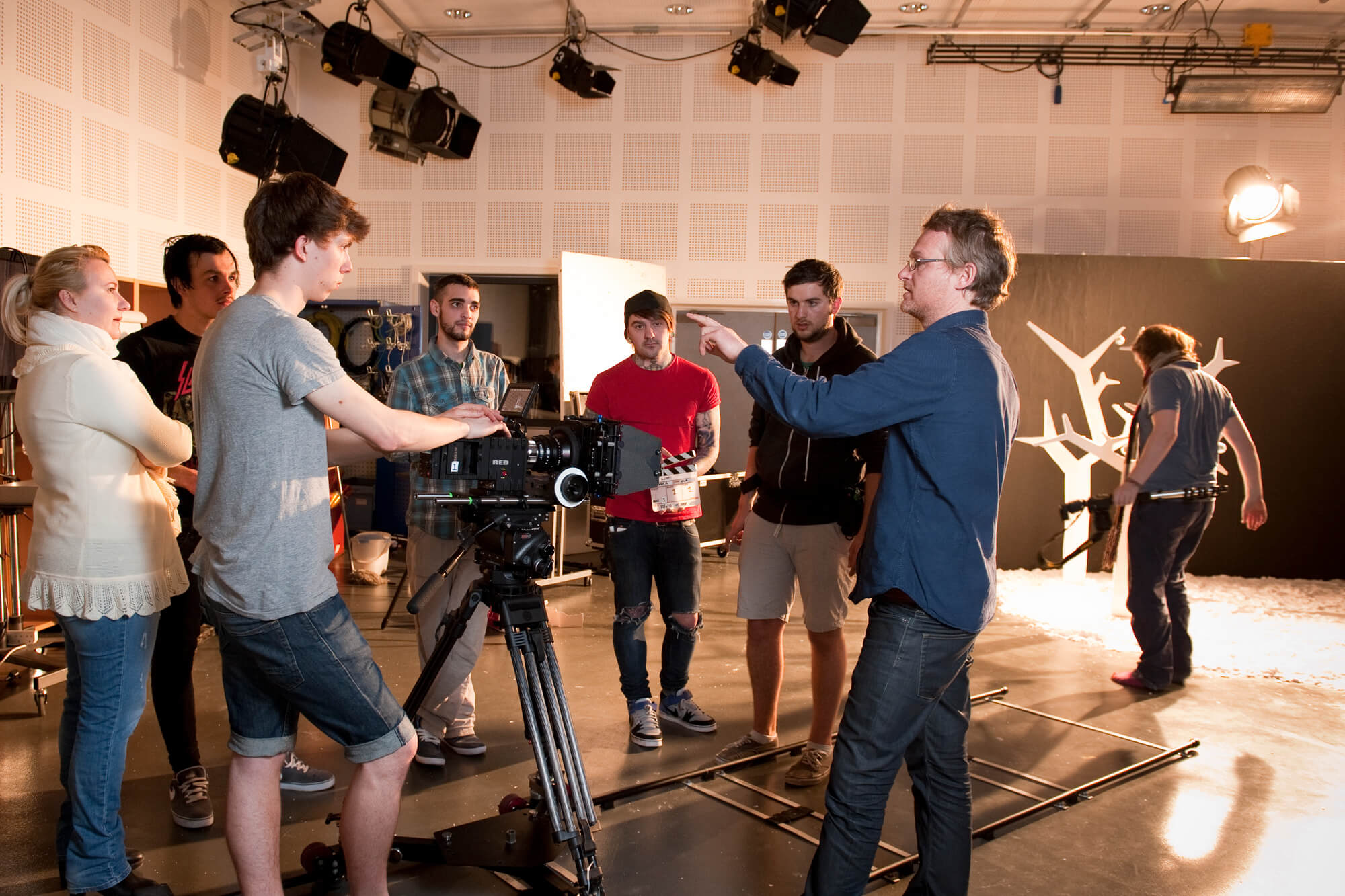 Students working with camera equipment in the Markeaton Street film and television studio.