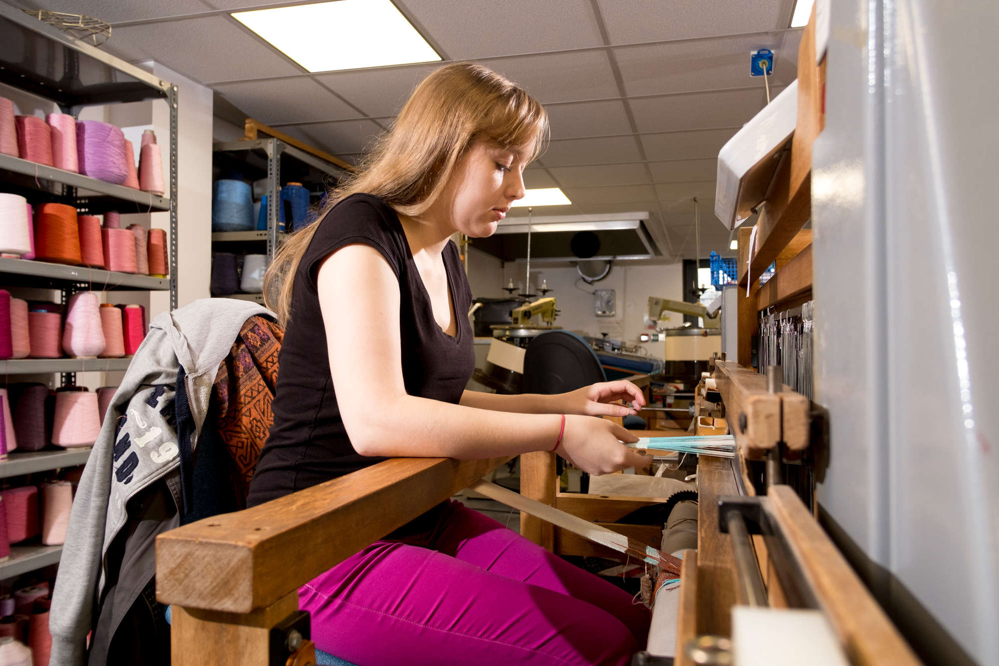A student working on a loom in Chandos Pole Street.