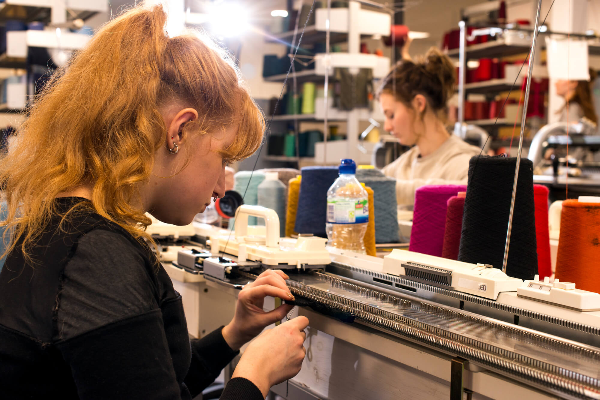 A student working in the fashion and textiles studios.