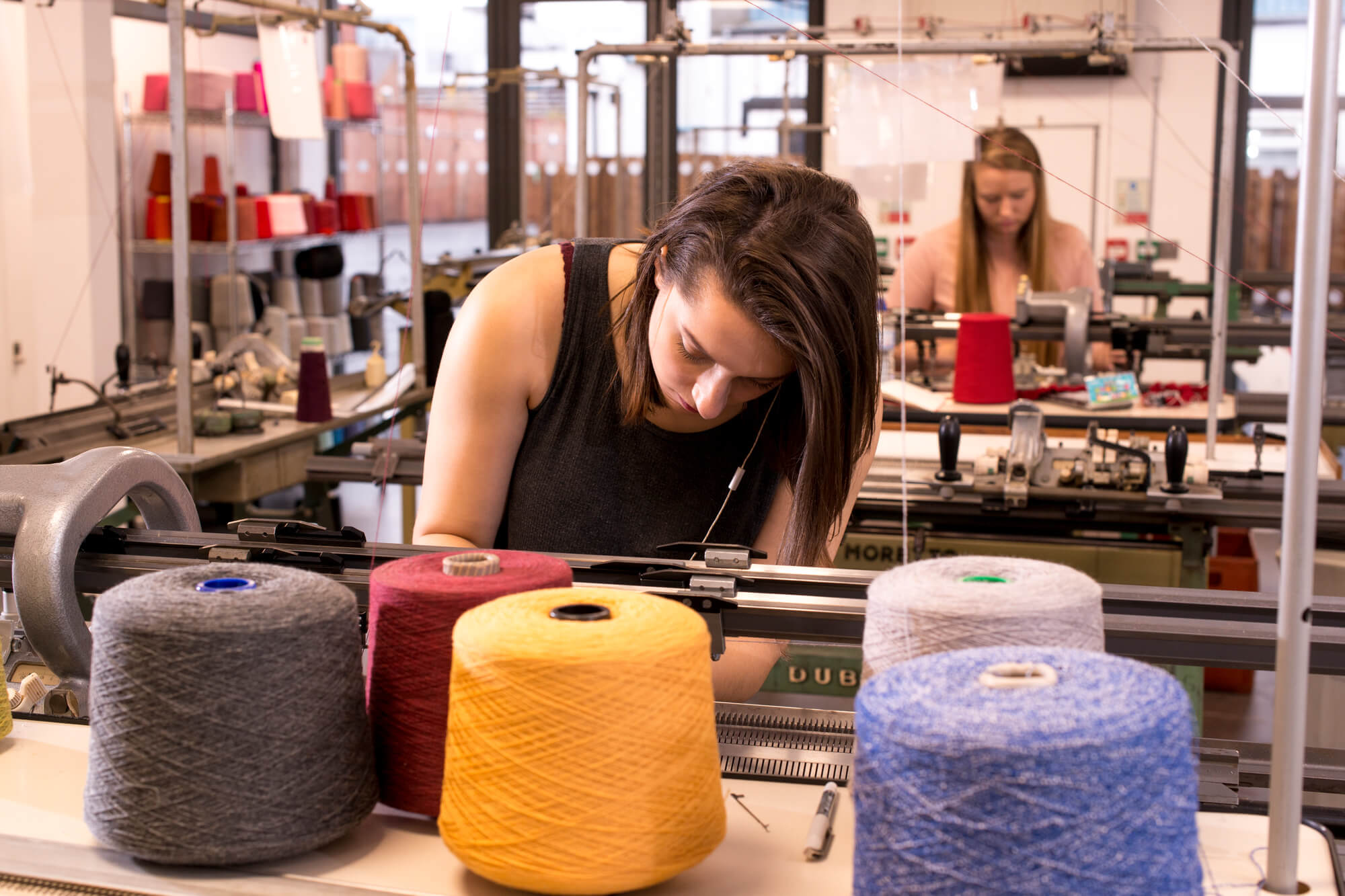 A student working in the Fashion and Textiles studio at the Chandos Pole Street site