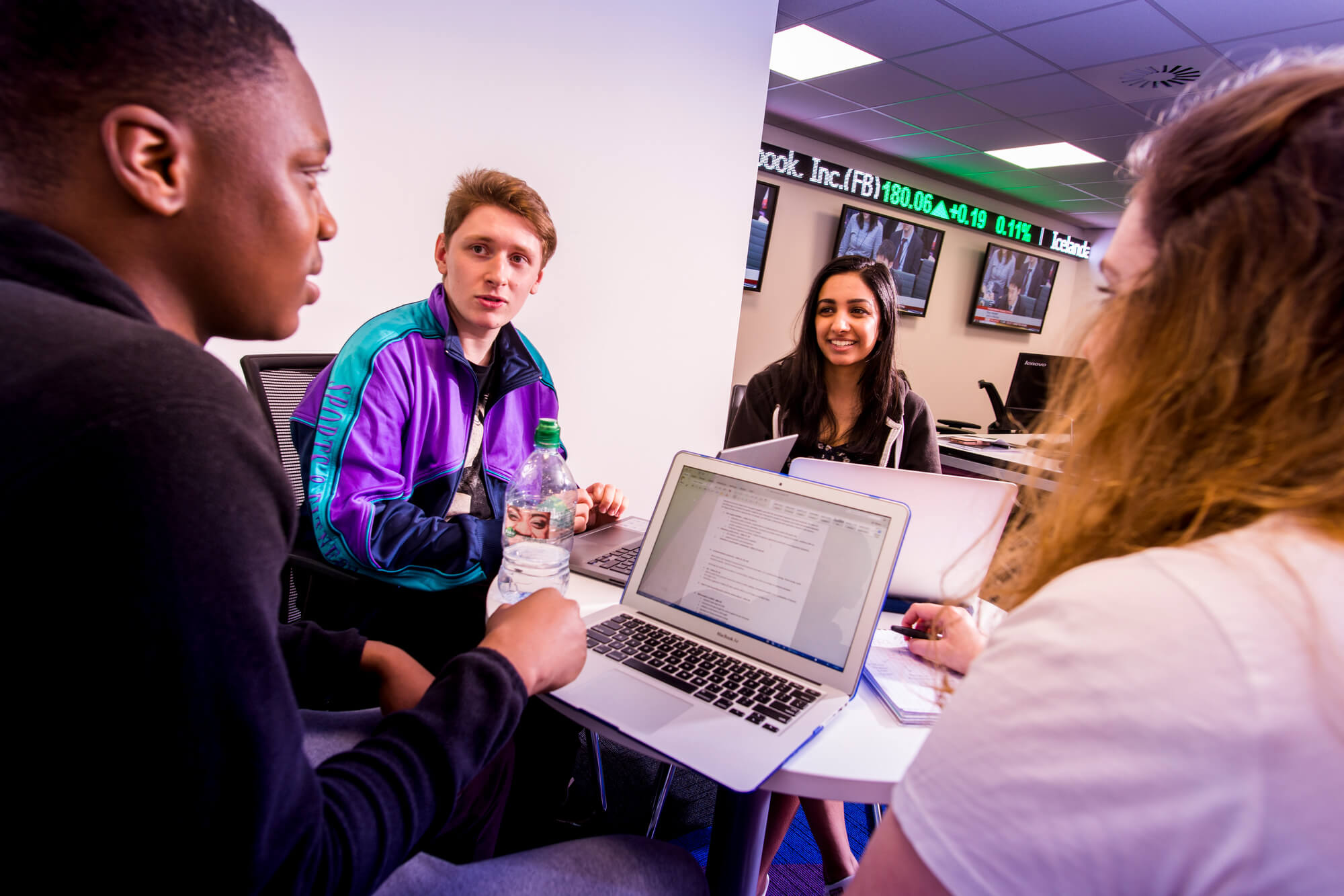 Students discussing their work in the Bloomberg facility