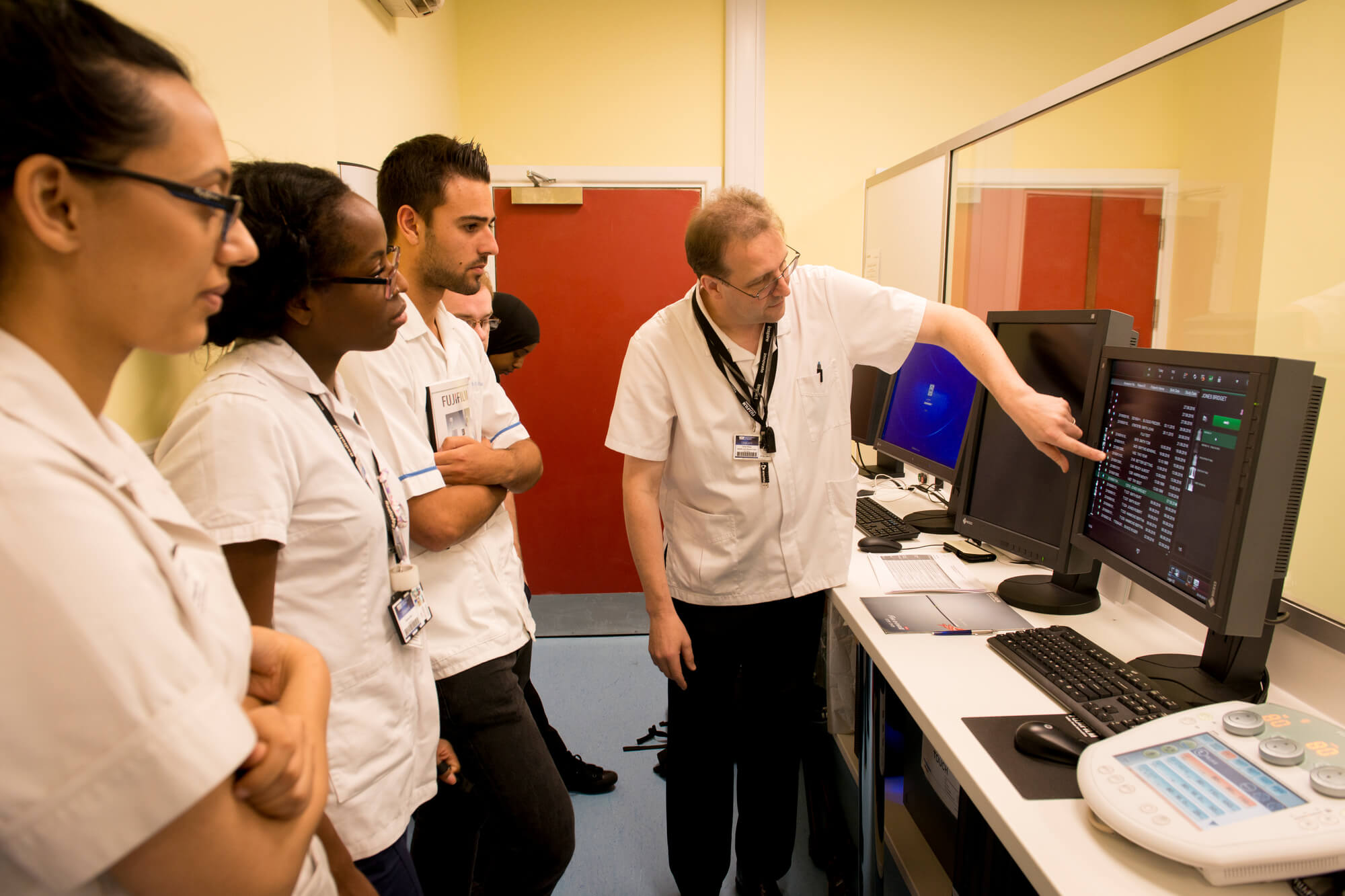 Group of students using diagnostic imaging equipment