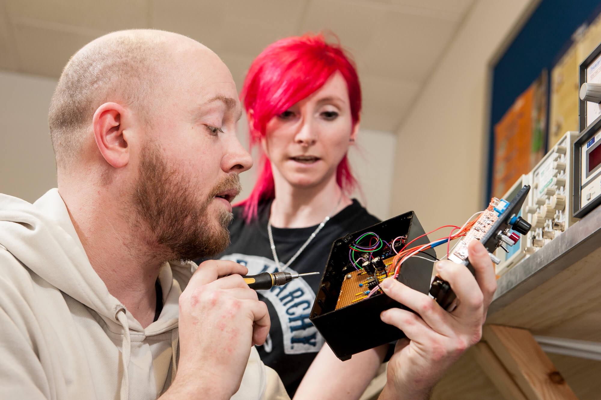 Electrical and Electronic Engineering students work on their own circuit boards