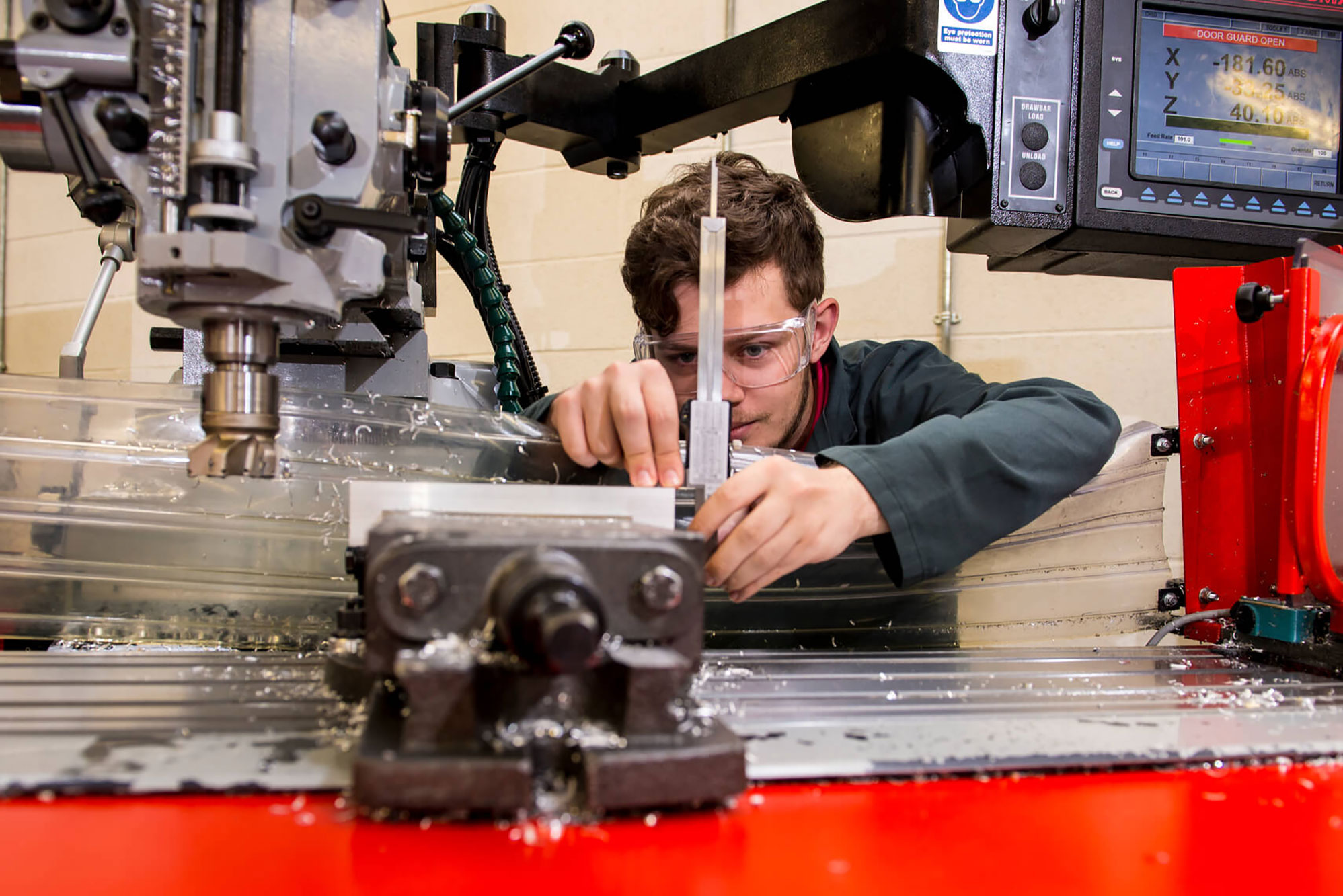 Mechanical Engineering student operating equipment in the workshops