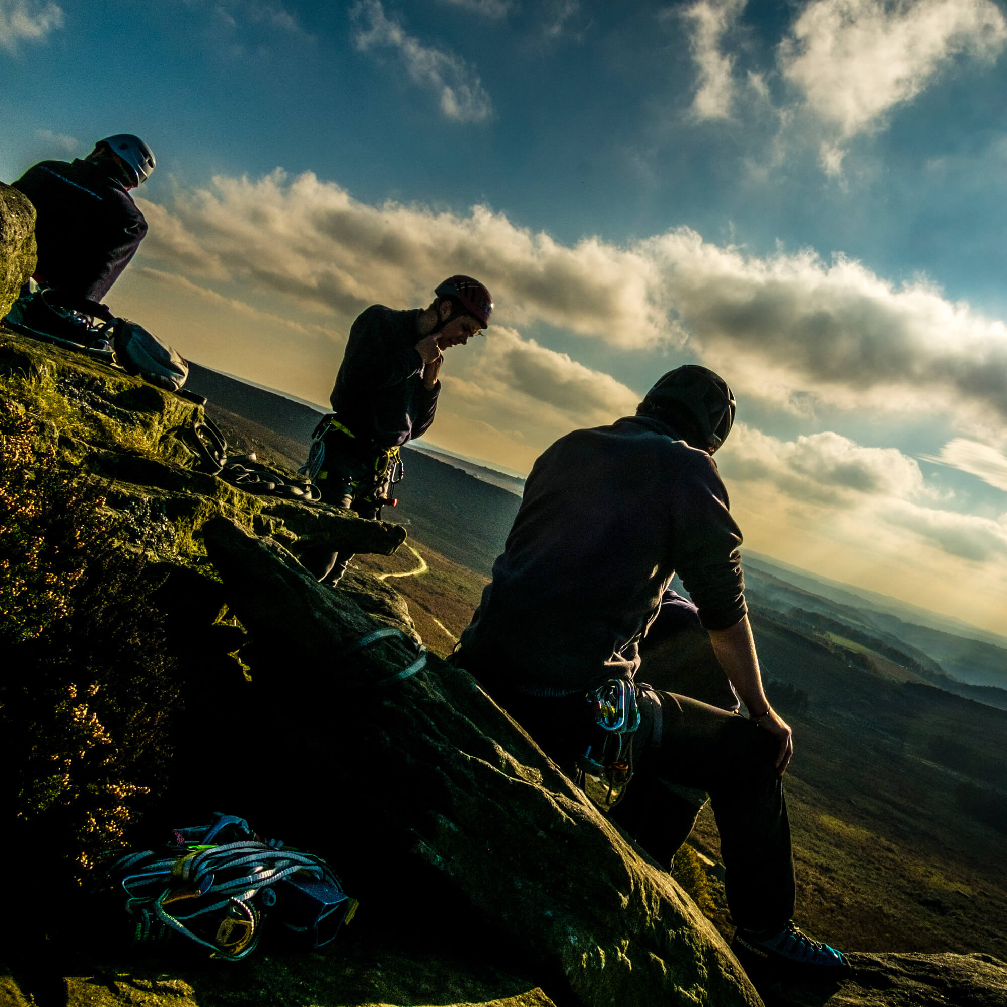 Outdoor students sitting on hillside at Burbage