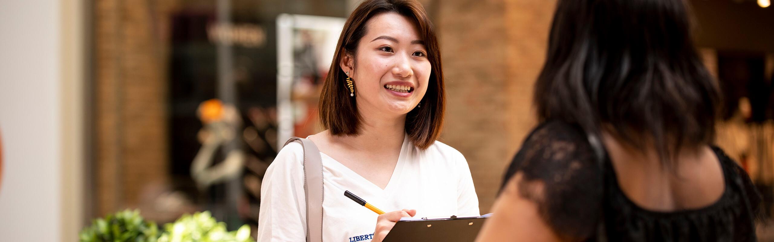 Bowen Shang interviewing a shopper
