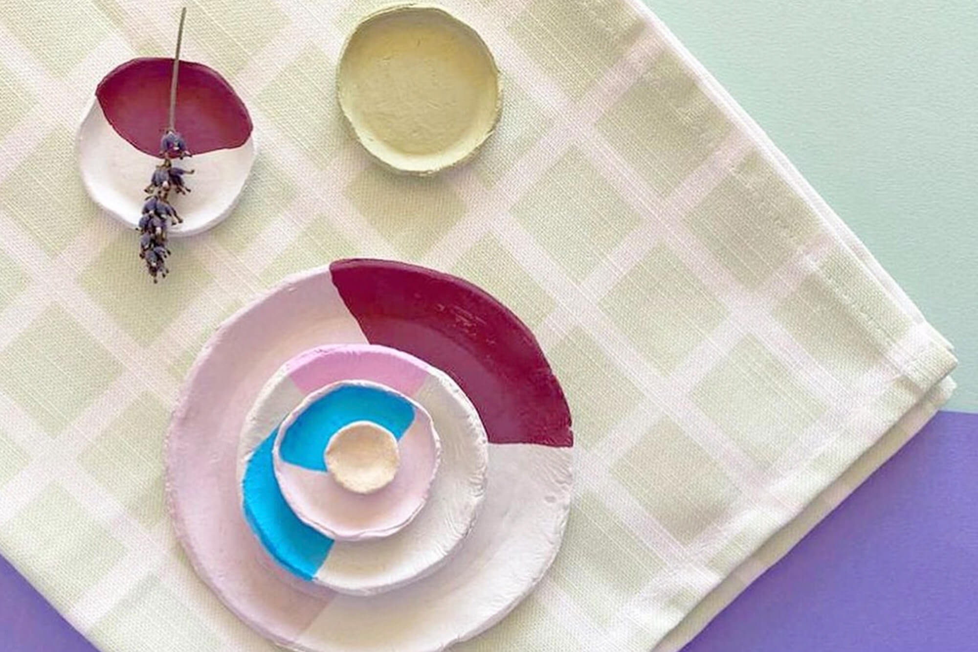 Colourful hand-painted bowls on a tablecloth
