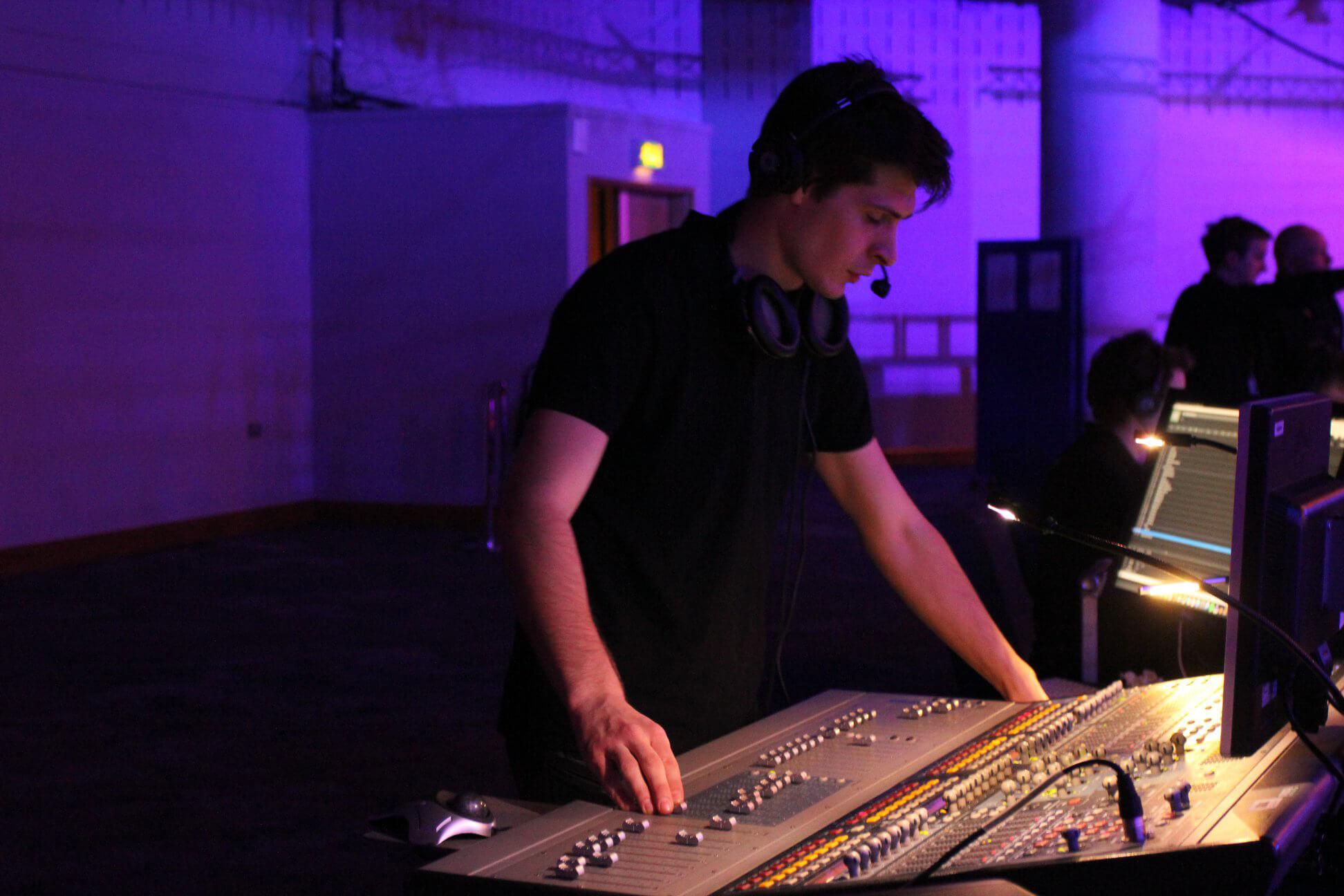Iustin Sandu working at a sound desk