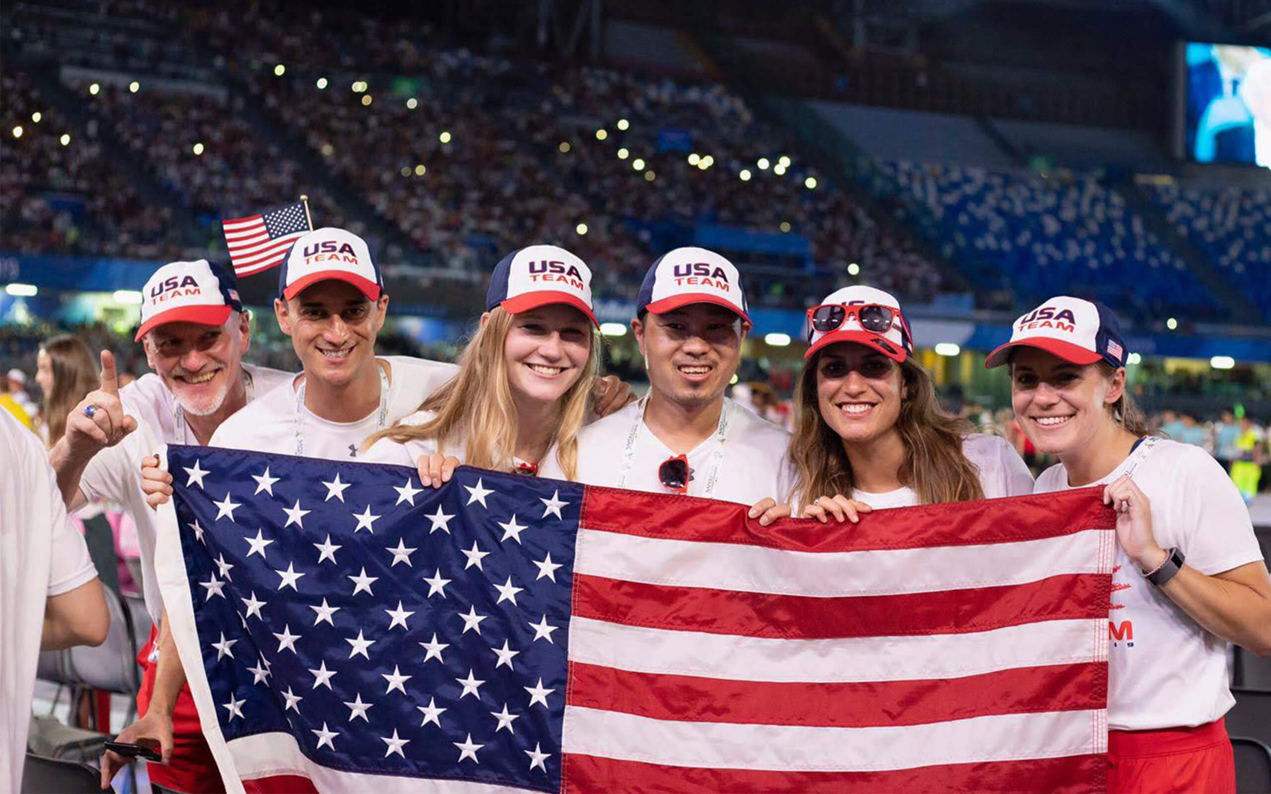 Graduate Chiara at the University games with team USA and USA flag