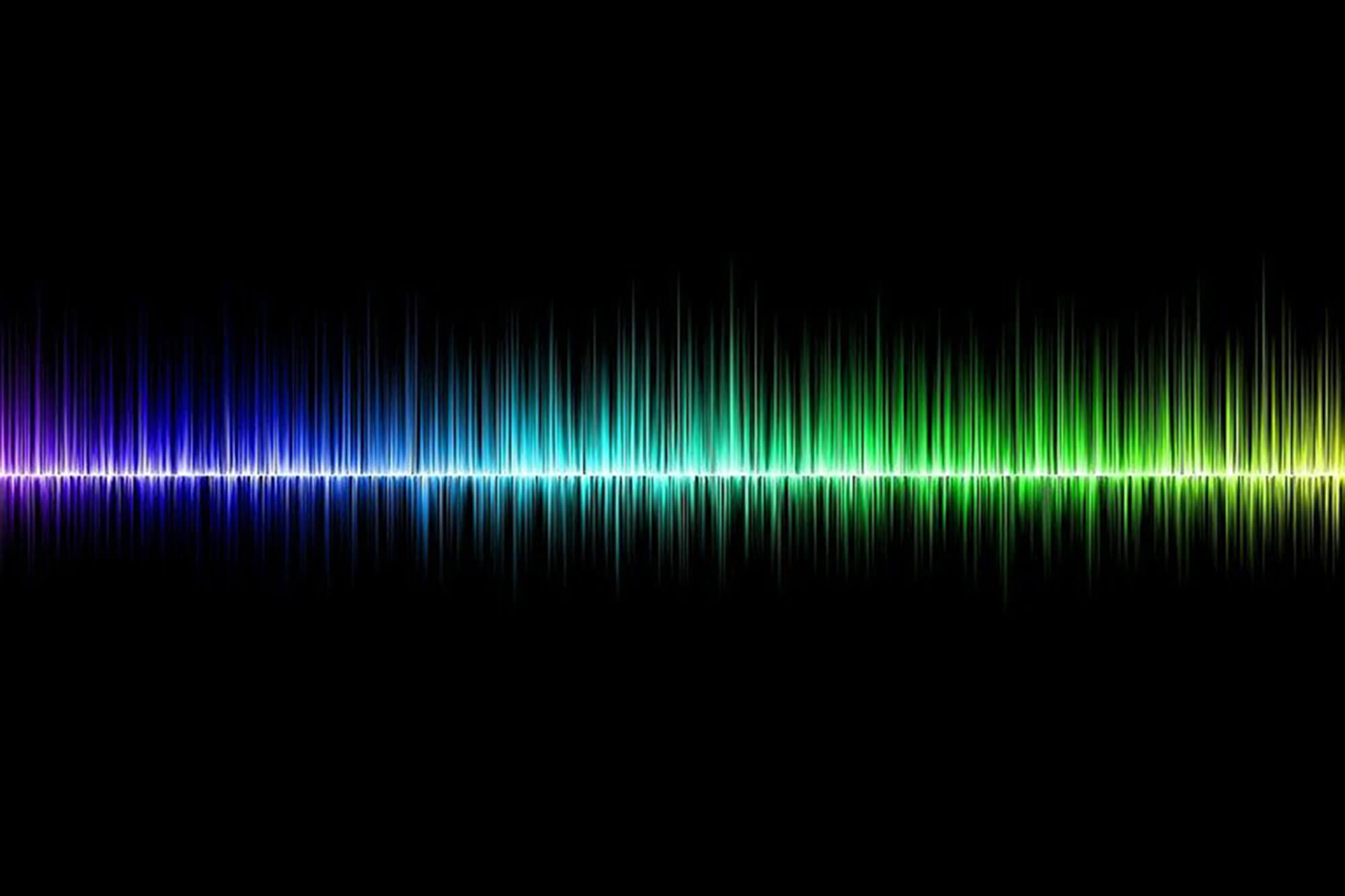 multicoloured sound waves on a black background
