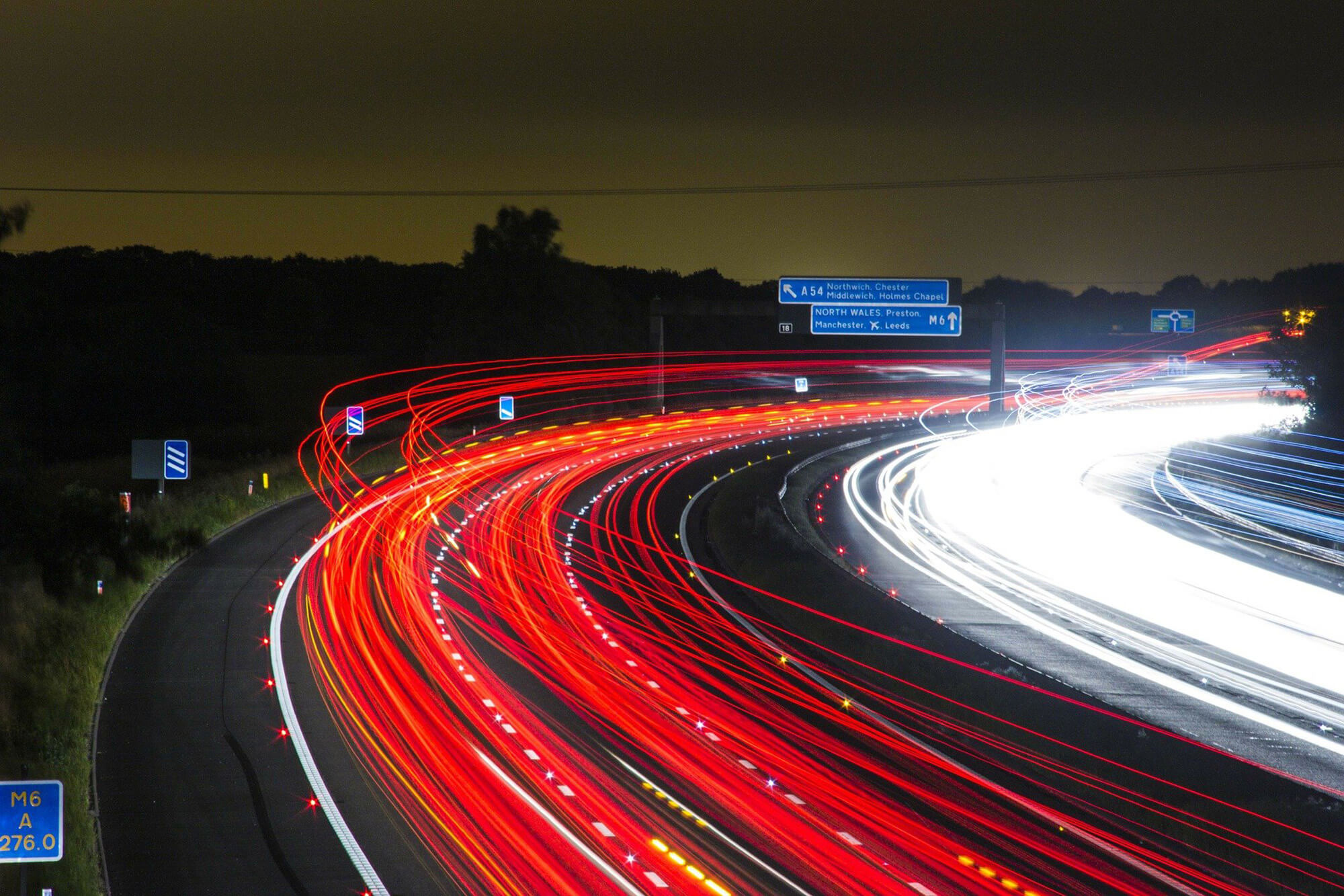 swooshes of lights from cars on the motorway