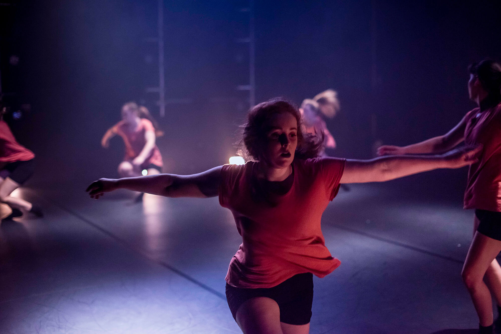Students perform an interpretive dance routine