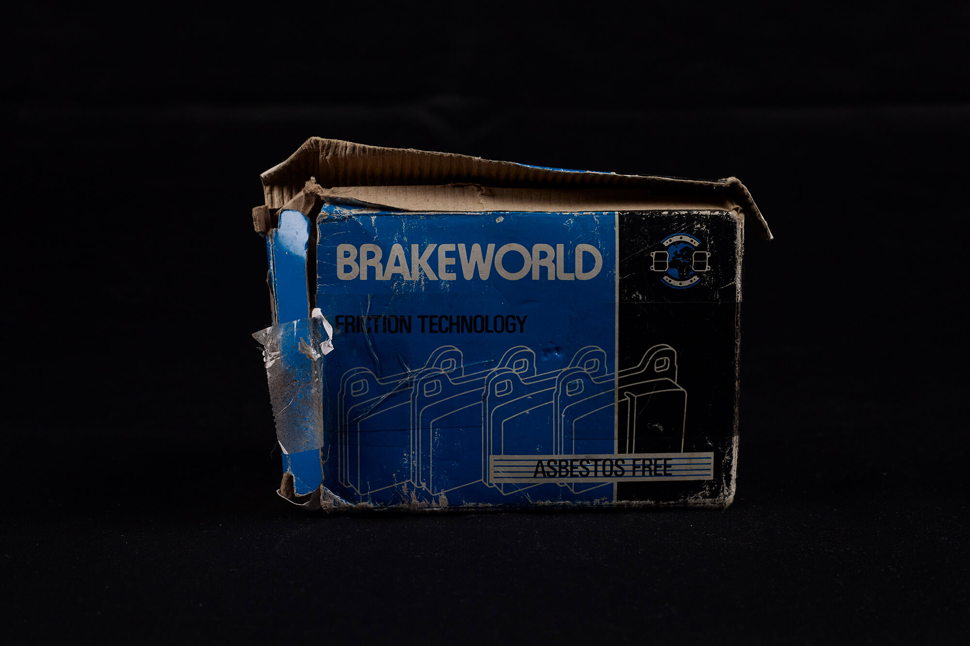 Close up image of a well worn blue and black cardboard box branded 'Brakeworld'