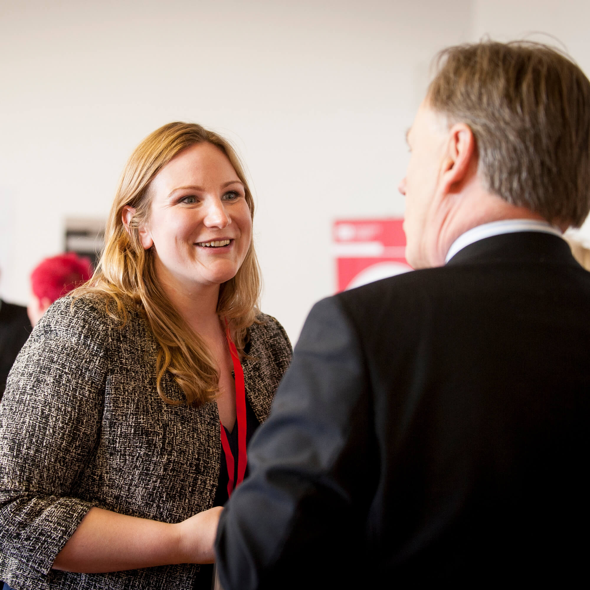 Woman talking to man at Institute of Education launch event